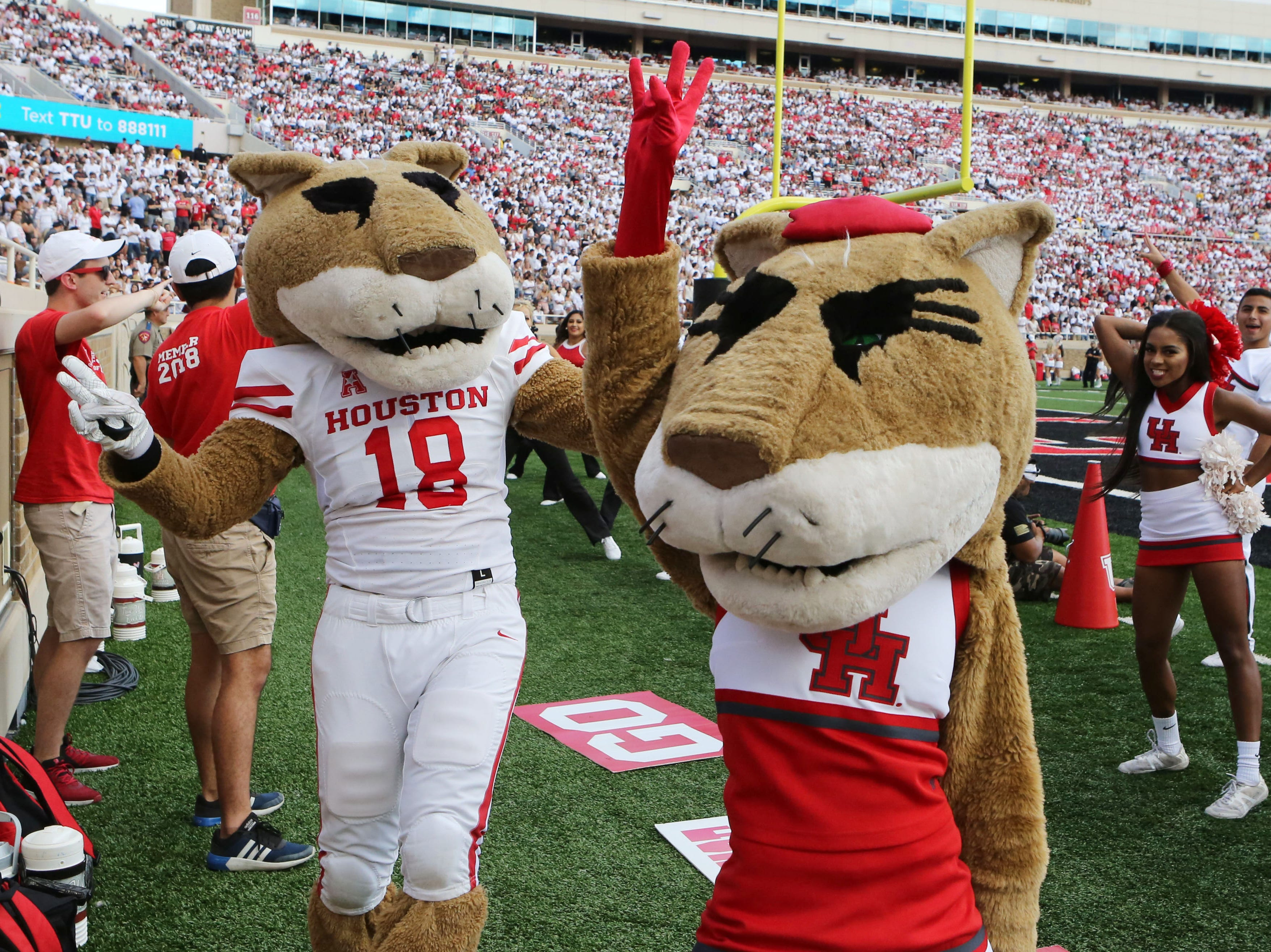 Week 3: The Houston Cougars mascots entertain the crowd during the game against the Texas Tech Red Raiders at Jones AT&T Stadium.