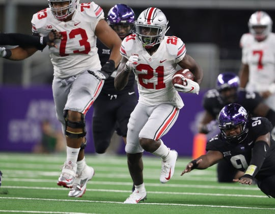 Ohio State receiver Parris Campbell runs after a catch for a touchdown in the third quarter against TCU at AT&T Stadium.