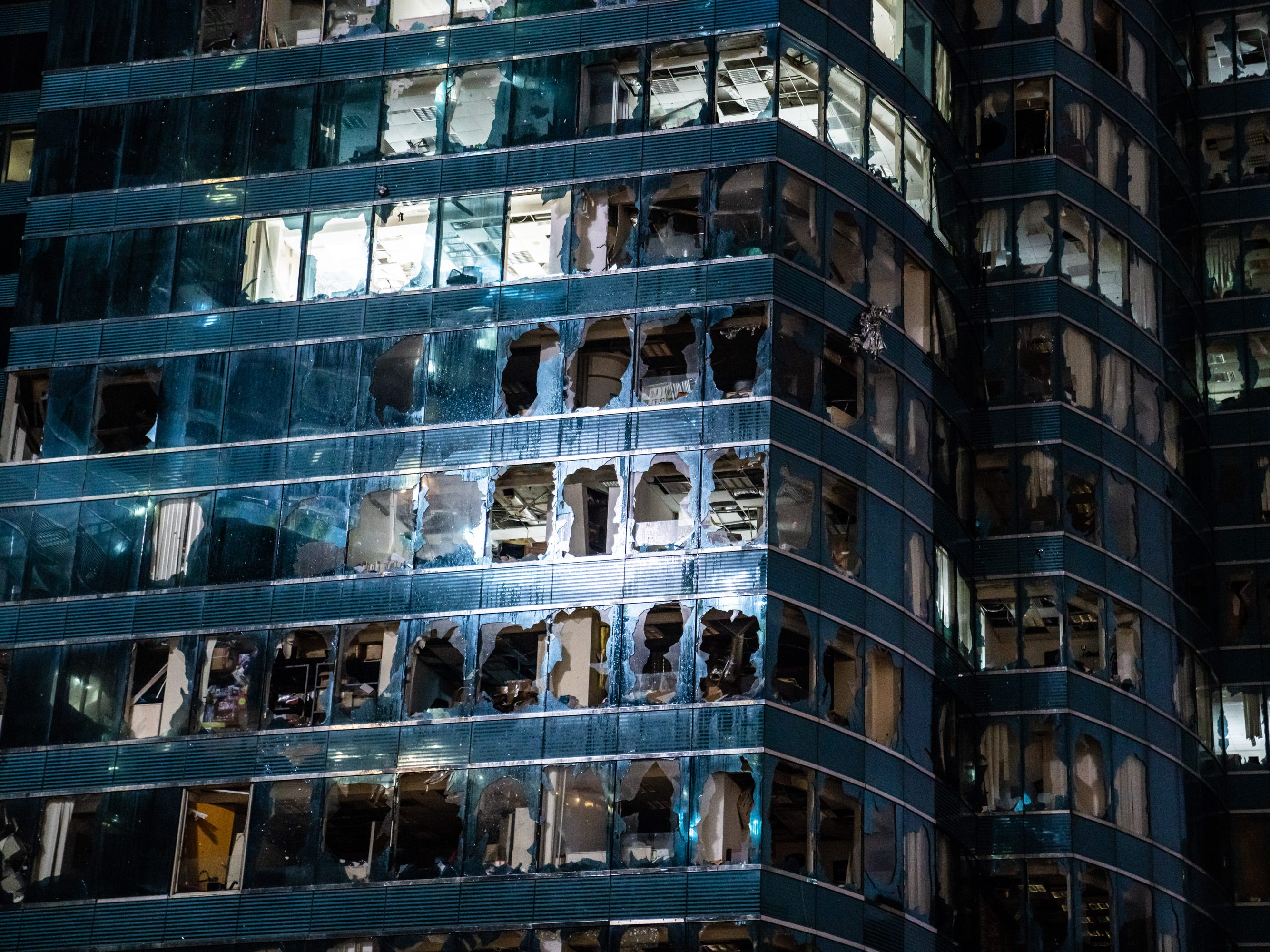 Windows of commercial building damaged by typhoon on Sept. 16, 2018 in Hong Kong. City officials raised the storm alert to T10, it's highest level,as Typhoon Mangkhut landed on Hong Kong. The strongest tropical storm of the season so far with winds as fast as 200 kilometers per hour, Mangkhut has reportedly killed at least 25 people in the Philippines as it continues it's path towards southern China.