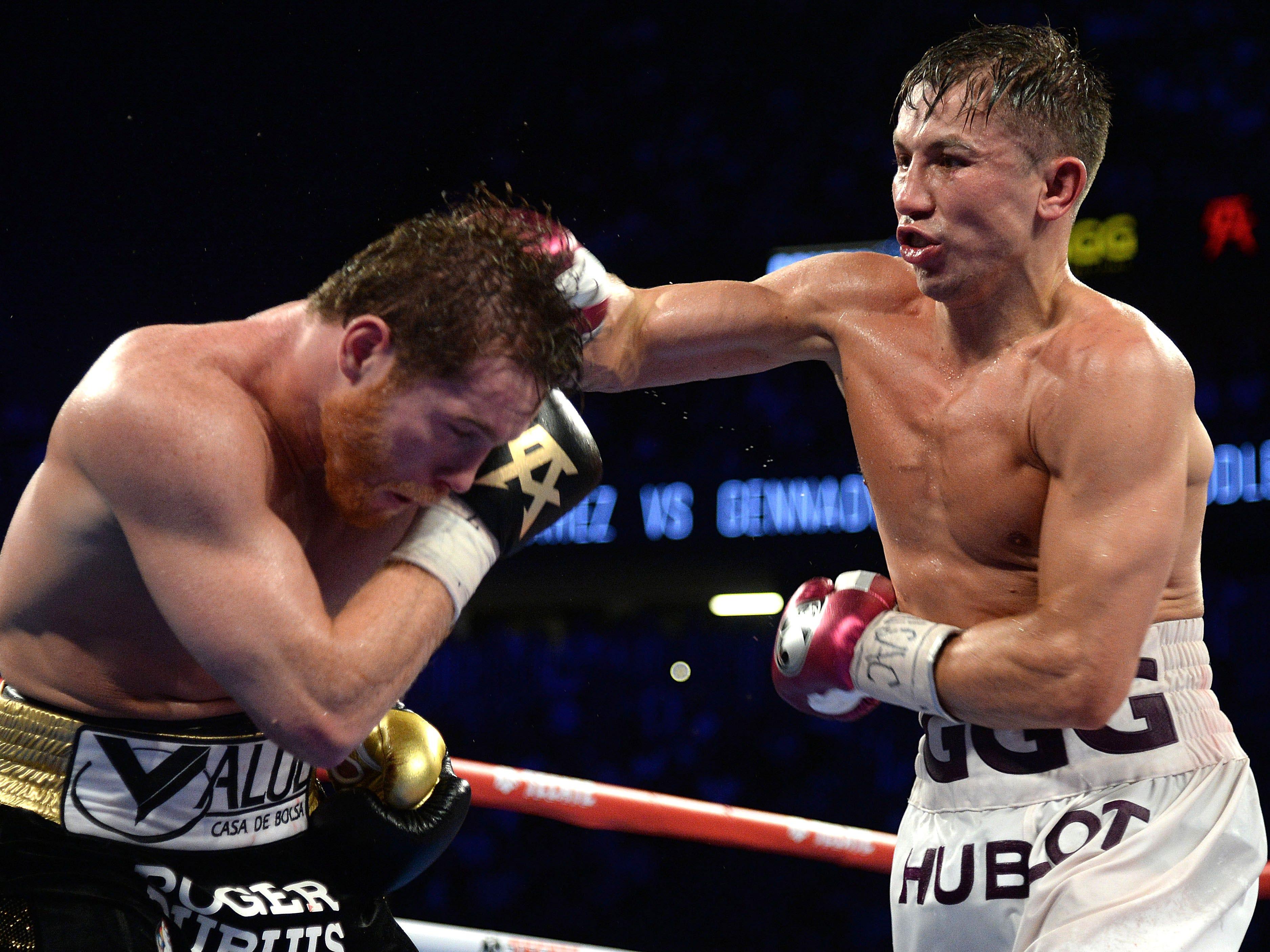 Golovkin throws a punch against Alvarez.
