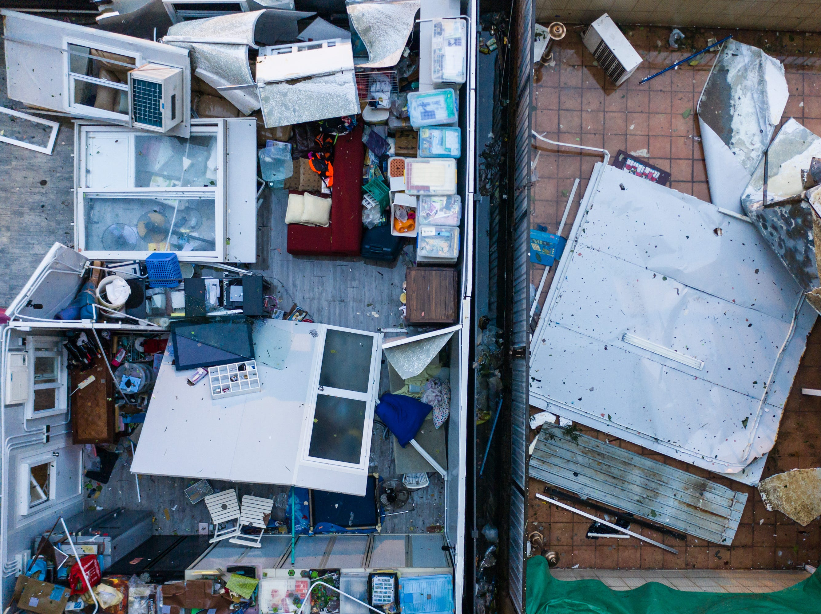 The roof of an apartment is damaged by Typhoon Mangkhuon Sept. 16, 2018 in Hong Kong.