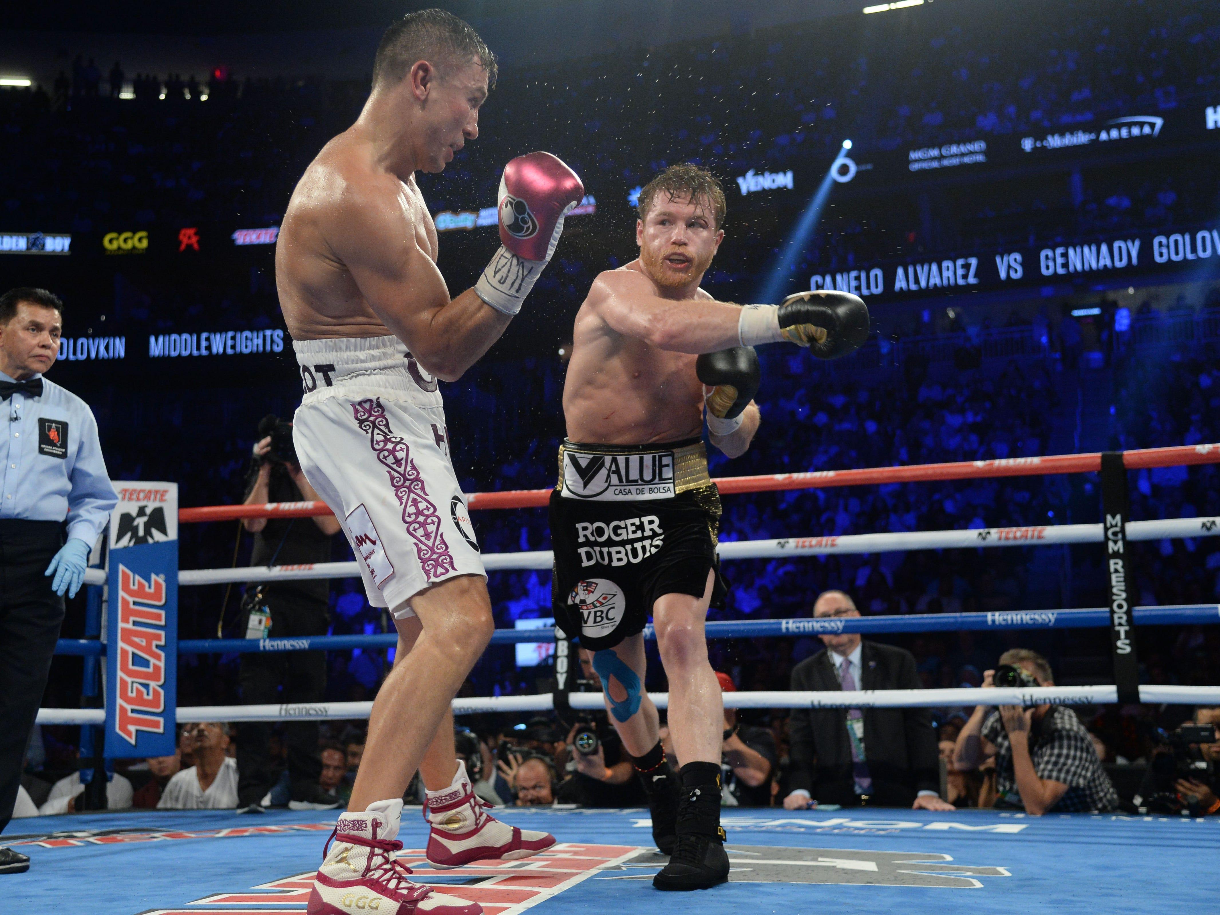 Alvarez takes a swing at Golovkin.