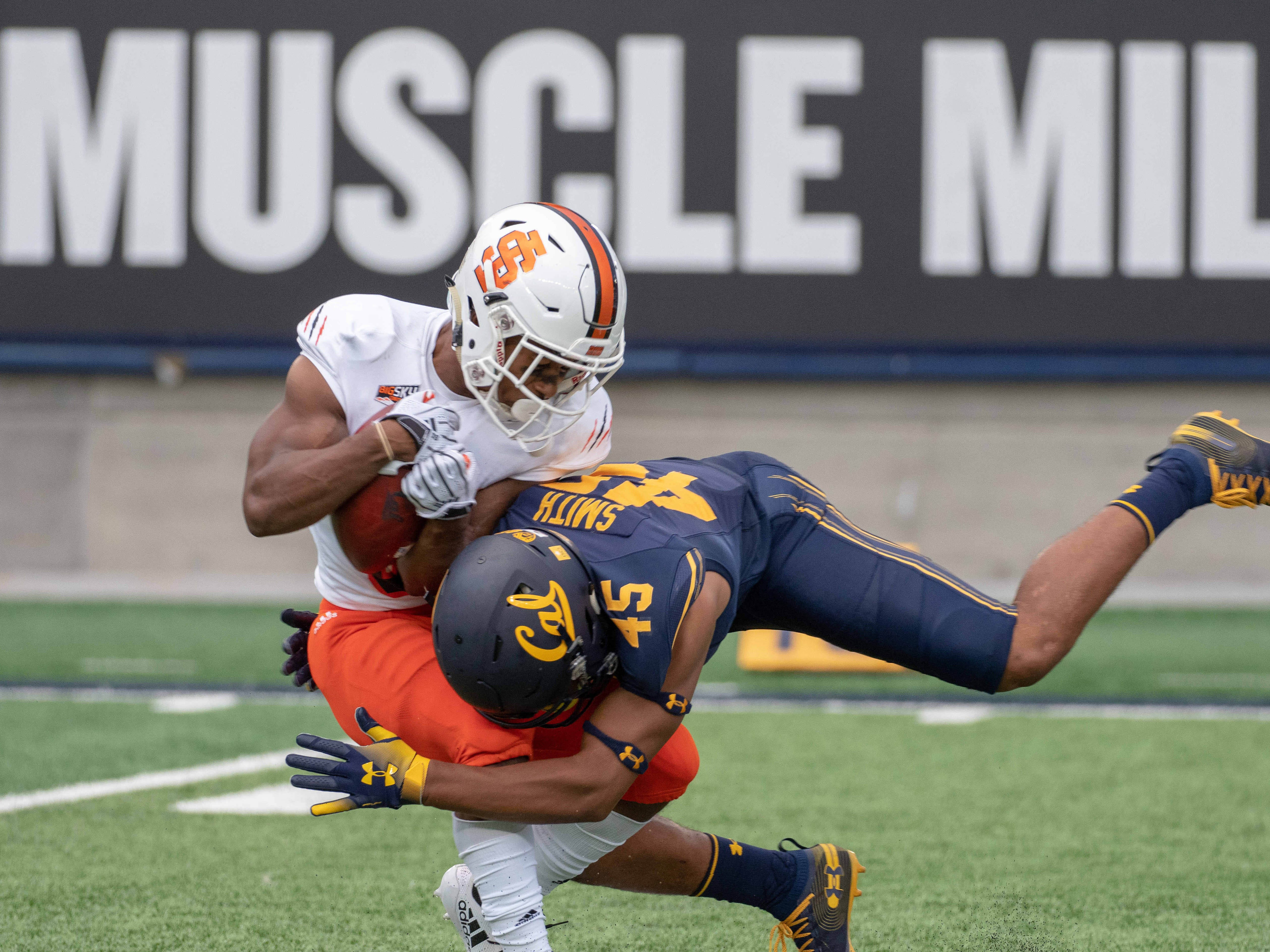 Idaho State Bengals defensive back Christian McFarland (5) is tackled by California Golden Bears cornerback Branden Smith (45) during the fourth quarter at California Memorial Stadium.