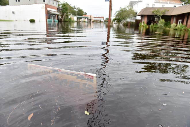 A campaign sign is under water on Pamlico St in Belhaven, N.C. on Saturday morning on September 15, 2018.