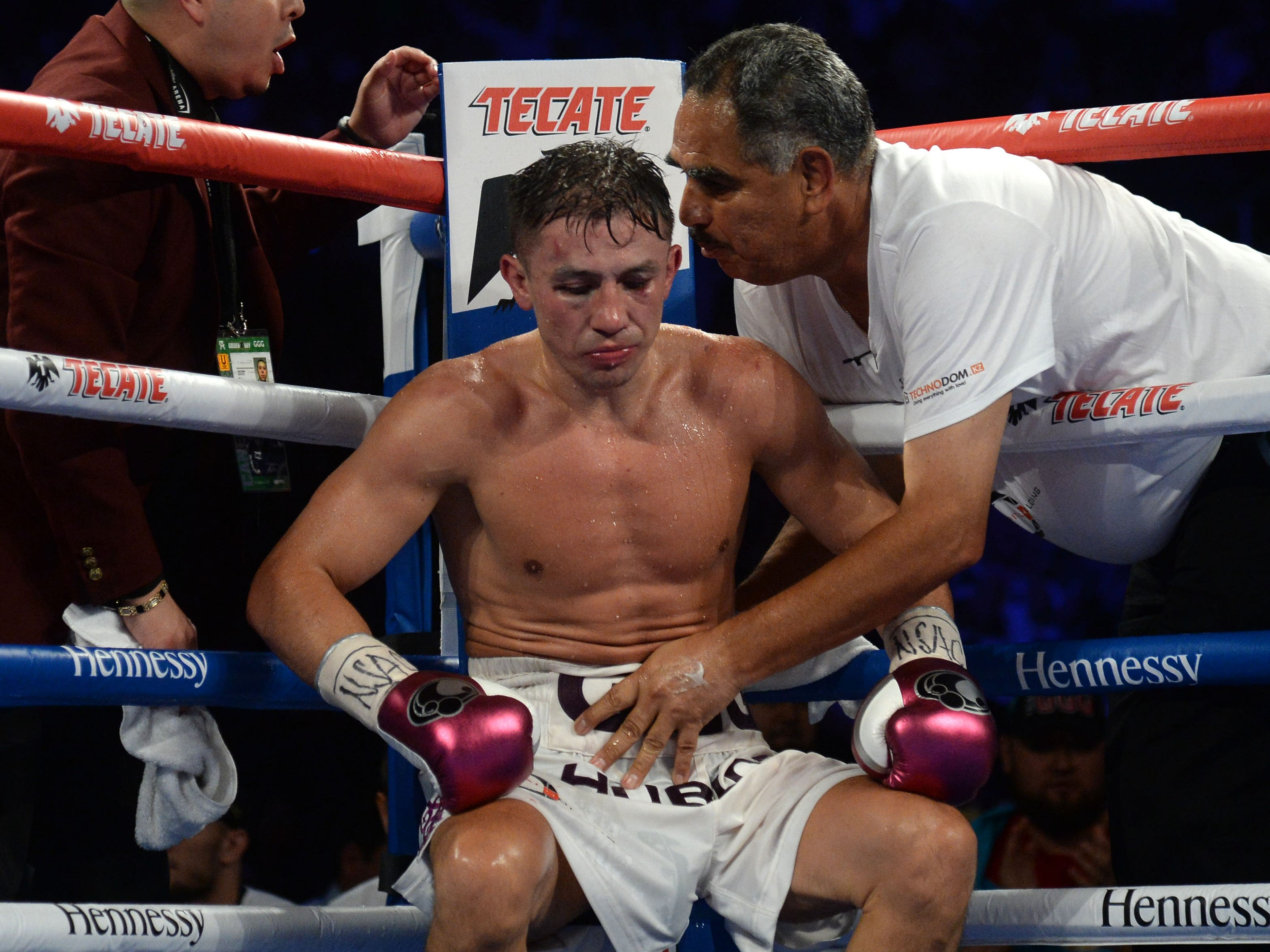 Golovkin gets instructions from trainer Abel Sanchez between rounds.
