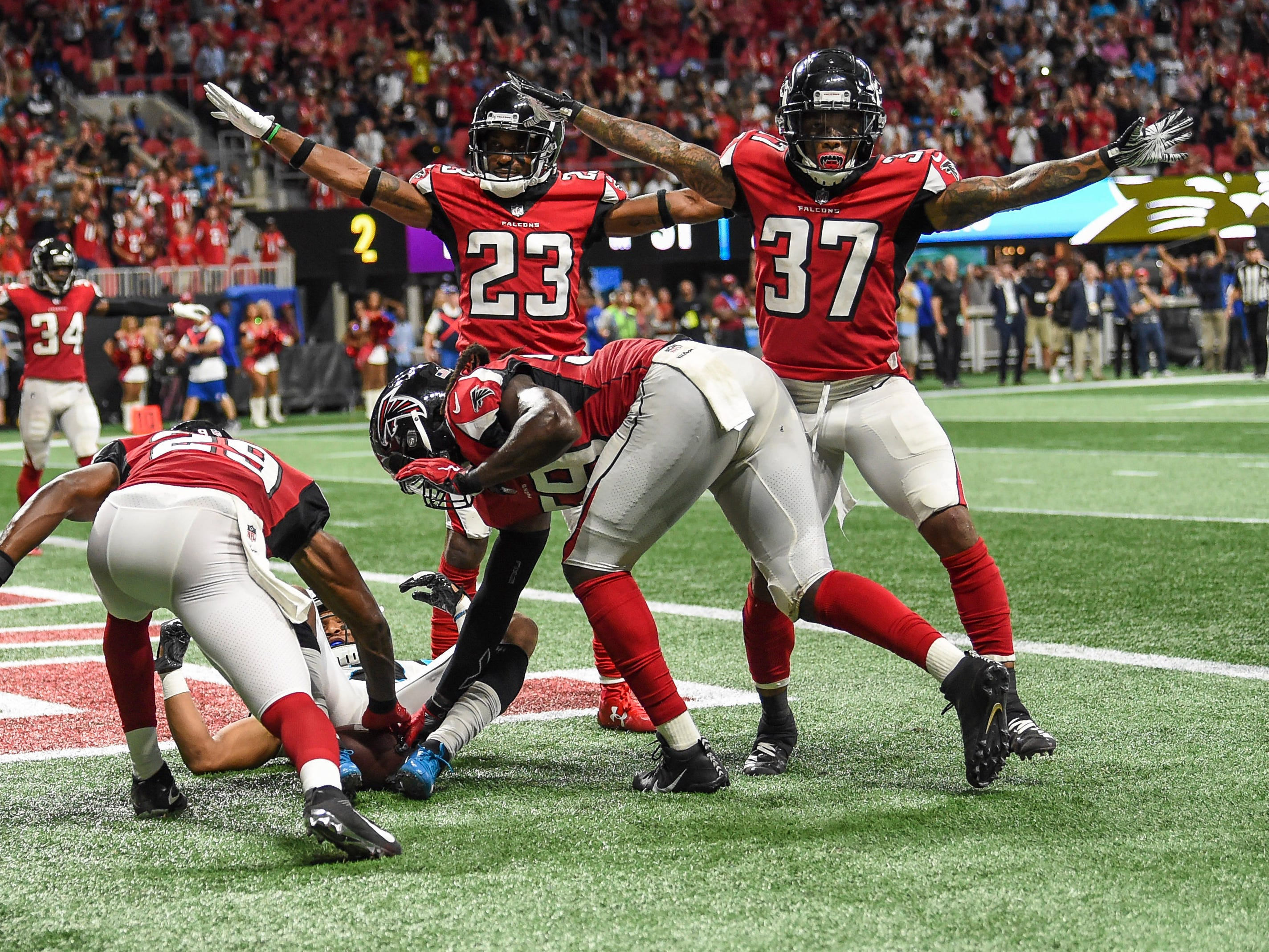 Sep 16, 2018; Atlanta, GA, USA; Atlanta Falcons defensive back Robert Alford (23) and cornerback Ricardo Allen (37) and linebacker De'Vondre Campbell (59) react after defending Carolina Panthers wide receiver DJ Moore (12) on the last play of the game at Mercedes-Benz Stadium. Mandatory Credit: Dale Zanine-USA TODAY Sports