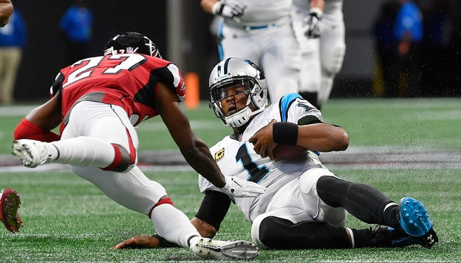 Carolina Panthers quarterback Cam Newton (1) slides down as Atlanta Falcons cornerback Damontae Kazee (27) prepares to hit Newton during the first half of an NFL football game, Sunday, Sept. 16, 2018, in Atlanta. Kazee was ejected from the game after the hit.