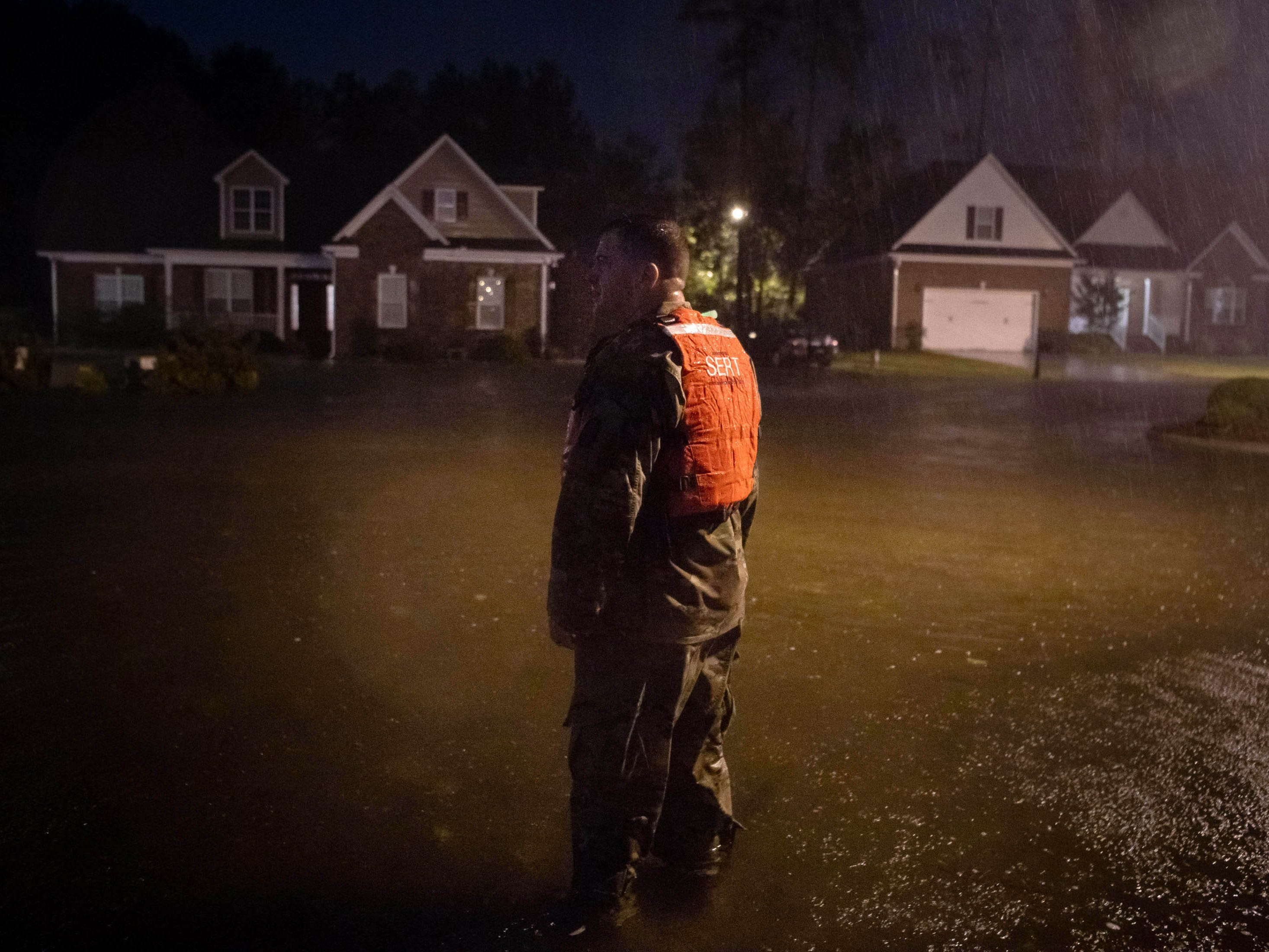 Command Sgt. Maj. Sid Baker of the North Carolina National Guard patrols a flooded neighborhood as rain from tropical storm Florence continues to fall on Lumberton, N.C., on Sept. 15, 2018.