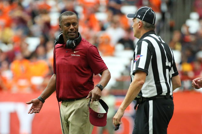 Florida State Seminoles head coach Willie Taggart reacts to a call against the Syracuse Orange during the second quarter at the Carrier Dome. Mandatory Credit: