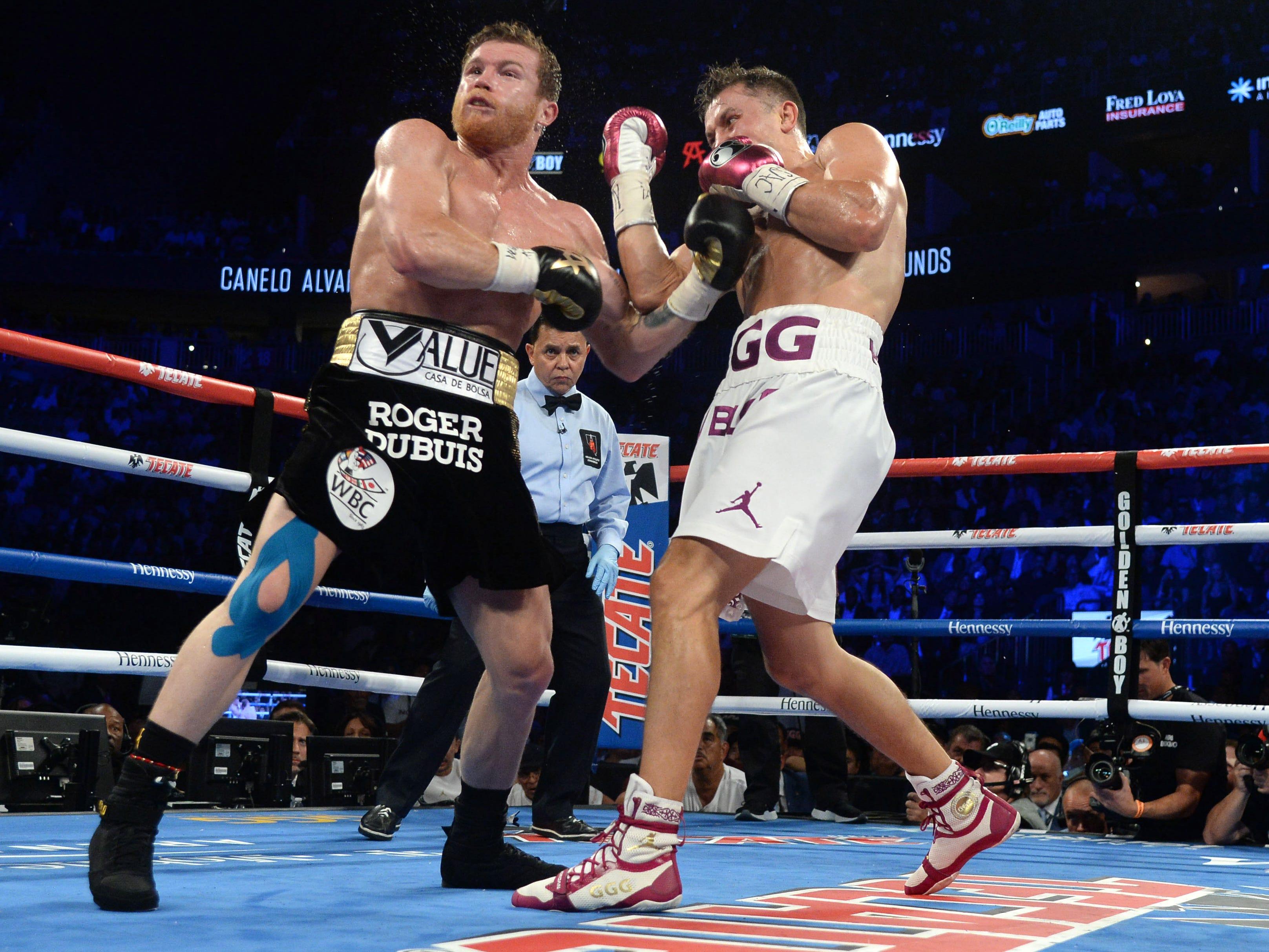 Golovkin lands a punch against Alvarez.