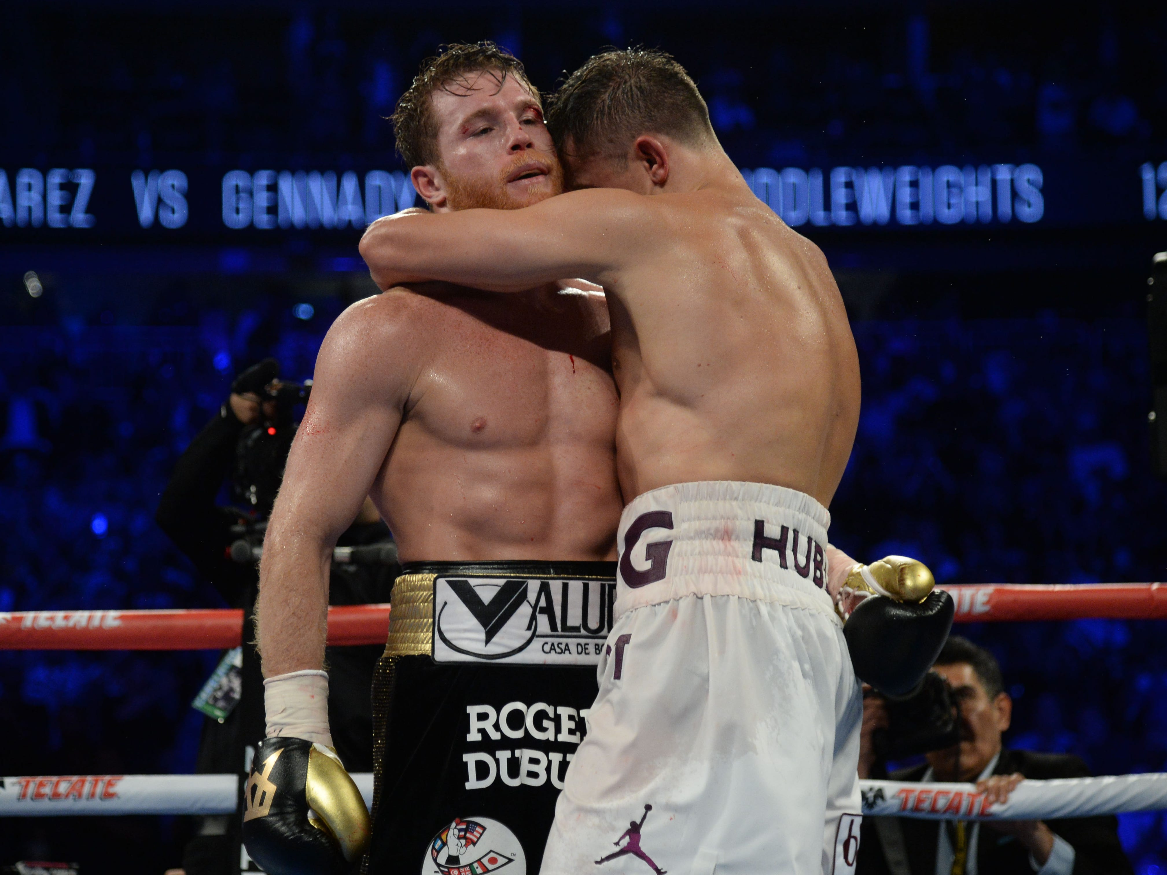 Exhausted, Alvarez and Golovkin embrace after the fight went the distance.