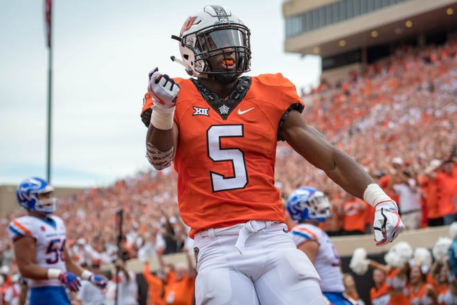 Oklahoma State Cowboys running back Justice Hill (5) reacts after a touchdown against the Boise State Broncos during the first half at Boone Pickens Stadium.