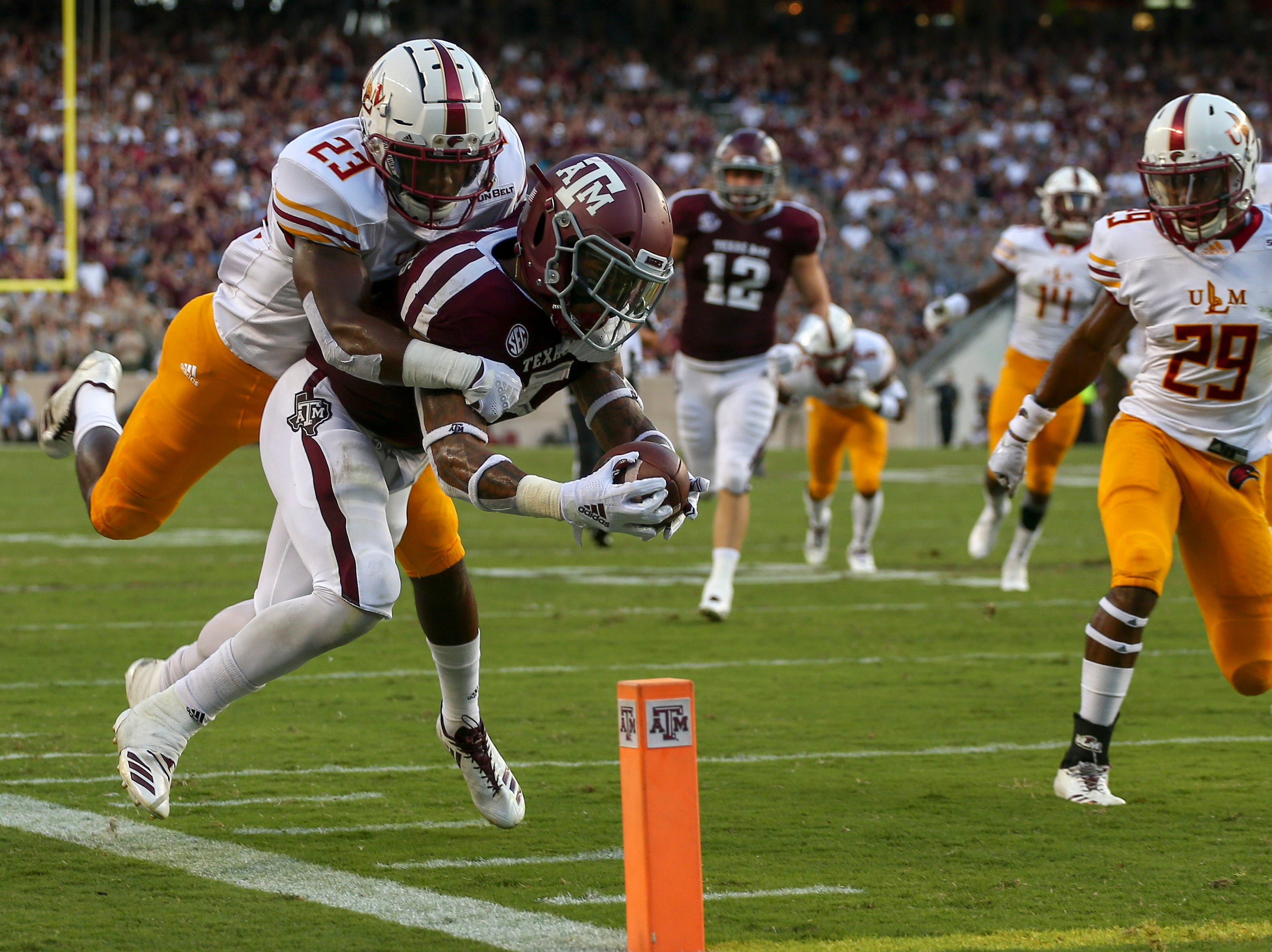 Texas A&M Aggies running back Trayveon Williams (5) dives for the pylon but goes out of bounds during the first quarter against the Louisiana-Monroe Warhawks at Kyle Field.