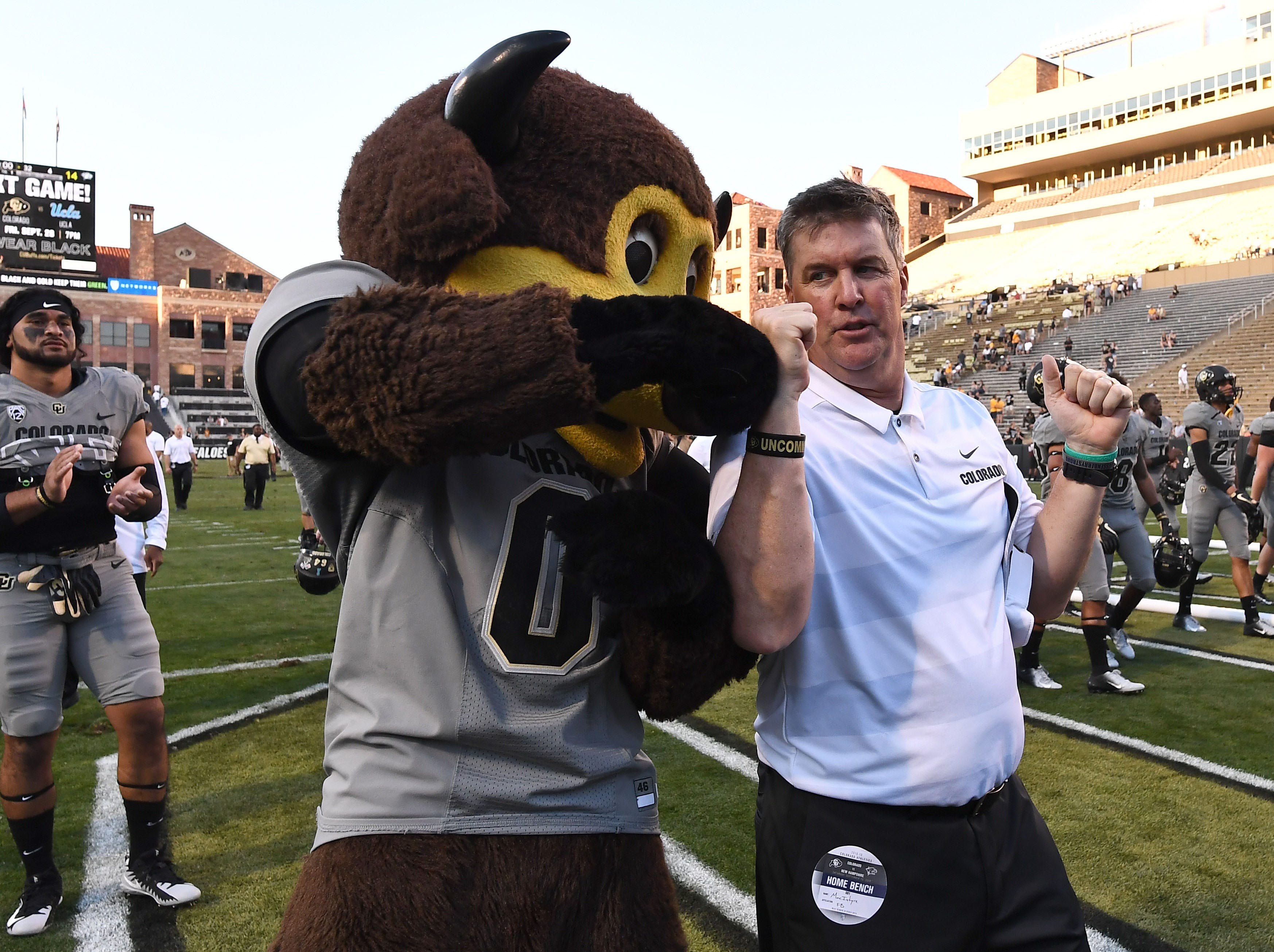 Week 3: Colorado Buffaloes head coach Mike MacIntyre fist-bumps mascot Chip following a win over the New Hampshire Wildcats at Folsom Field.
