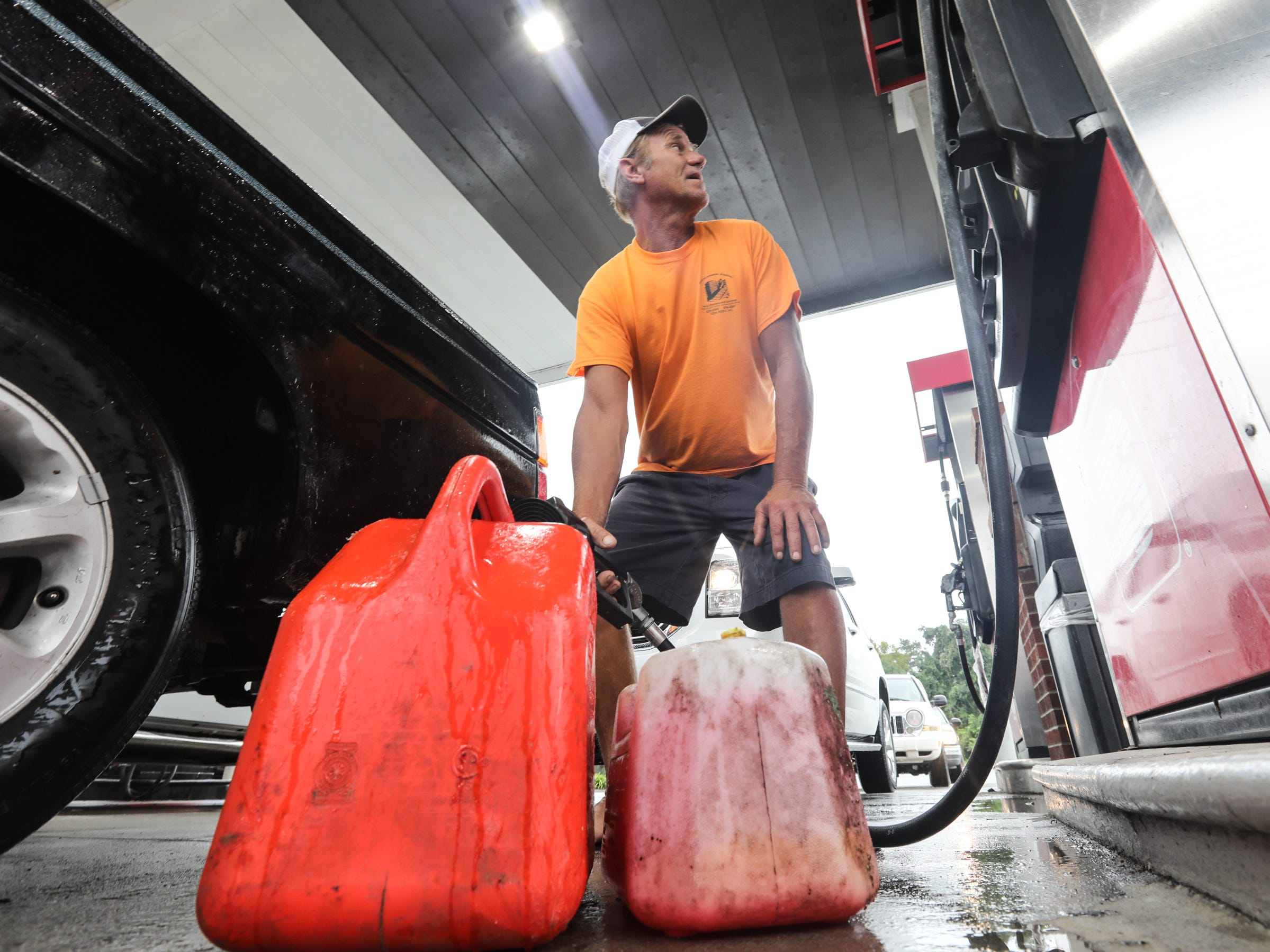 George Bloomberg fills gas cans at a gas station in Bridgeton, N.C. on Sunday, Sept. 16, 2018.
