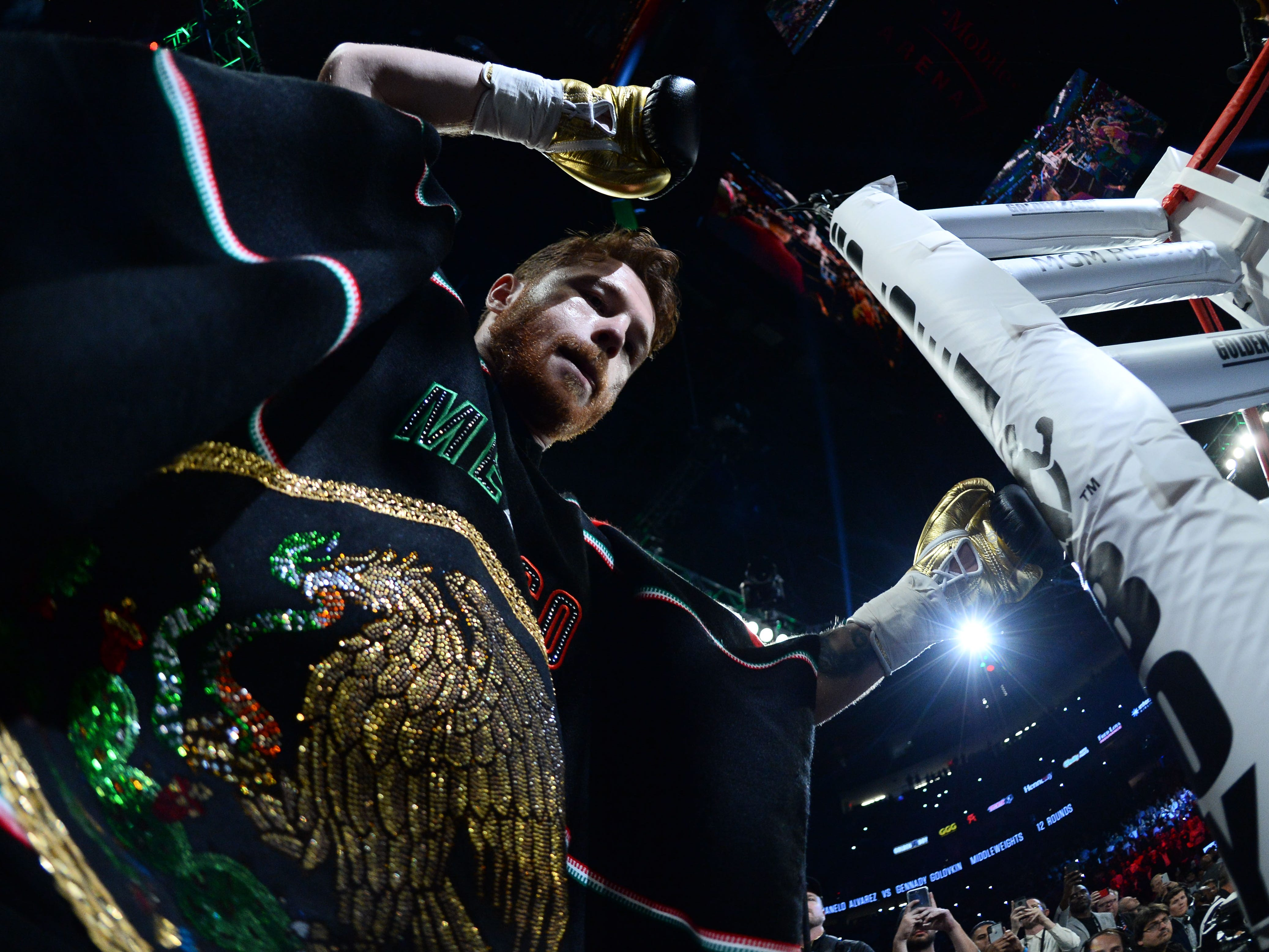 Alvarez enters the ring.