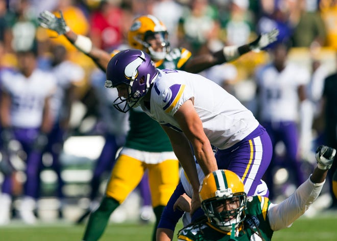 Minnesota Vikings kicker Daniel Carlson (7) reacts after missing a game winning field goal as time expires during overtime against the Green Bay Packers at Lambeau Field.