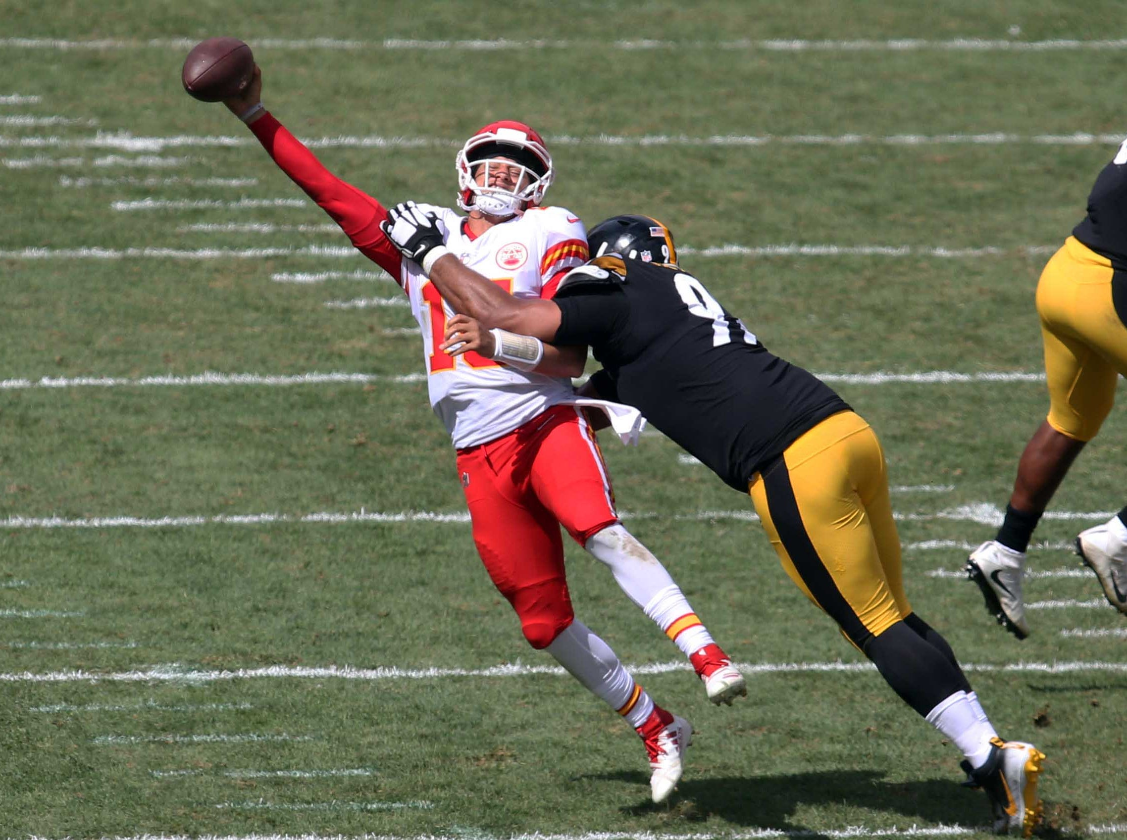 Pittsburgh Steelers defensive tackle Cameron Heyward pressures Kansas City Chiefs quarterback Patrick Mahomes as he throws during the second quarter at Heinz Field.