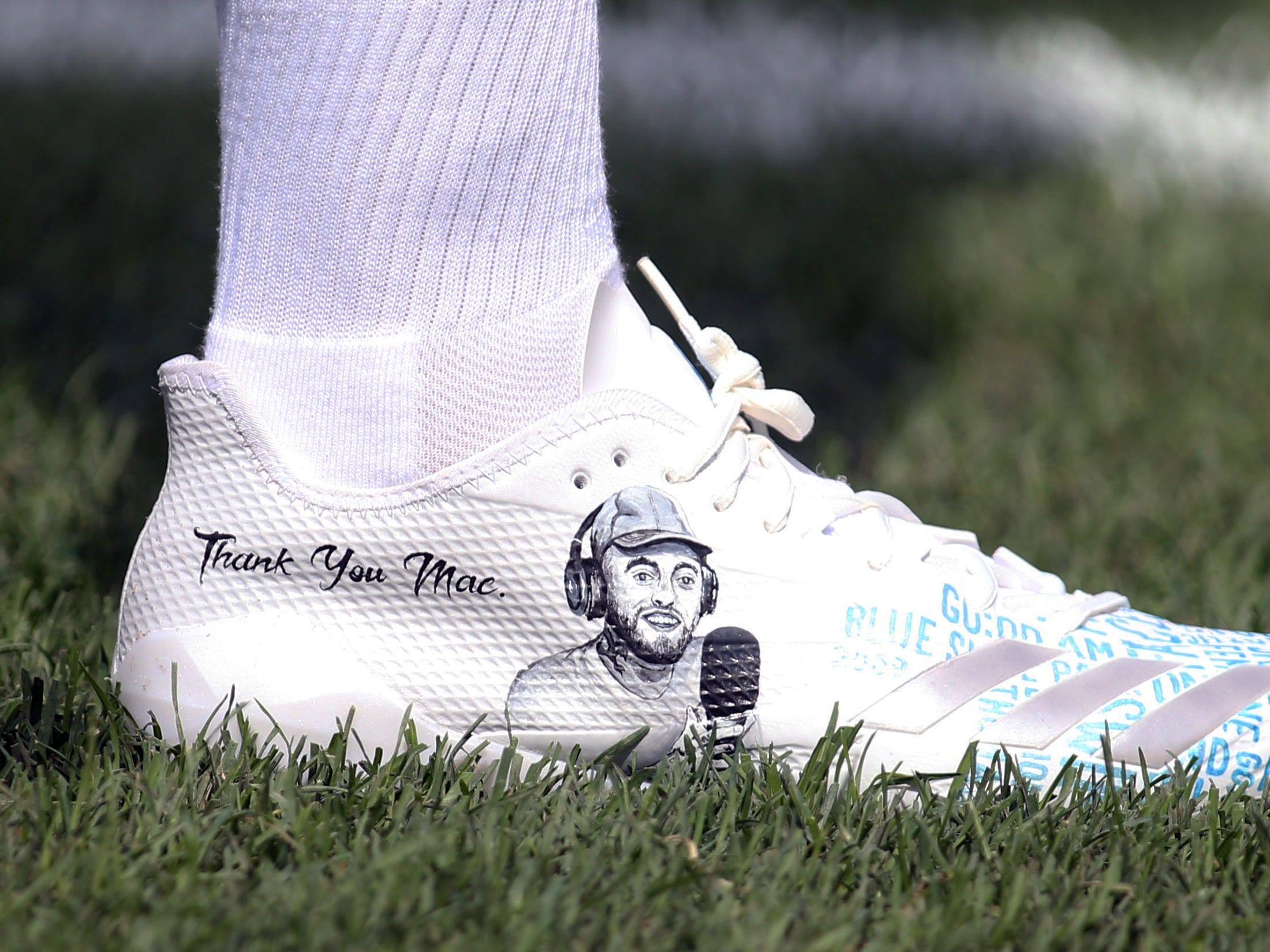 Detail view of the shoes of Pittsburgh Steelers running back James Conner in honor of deceased Pittsburgh based recording artist Mac Miller before the game against the Kansas City Chiefs at Heinz Field.