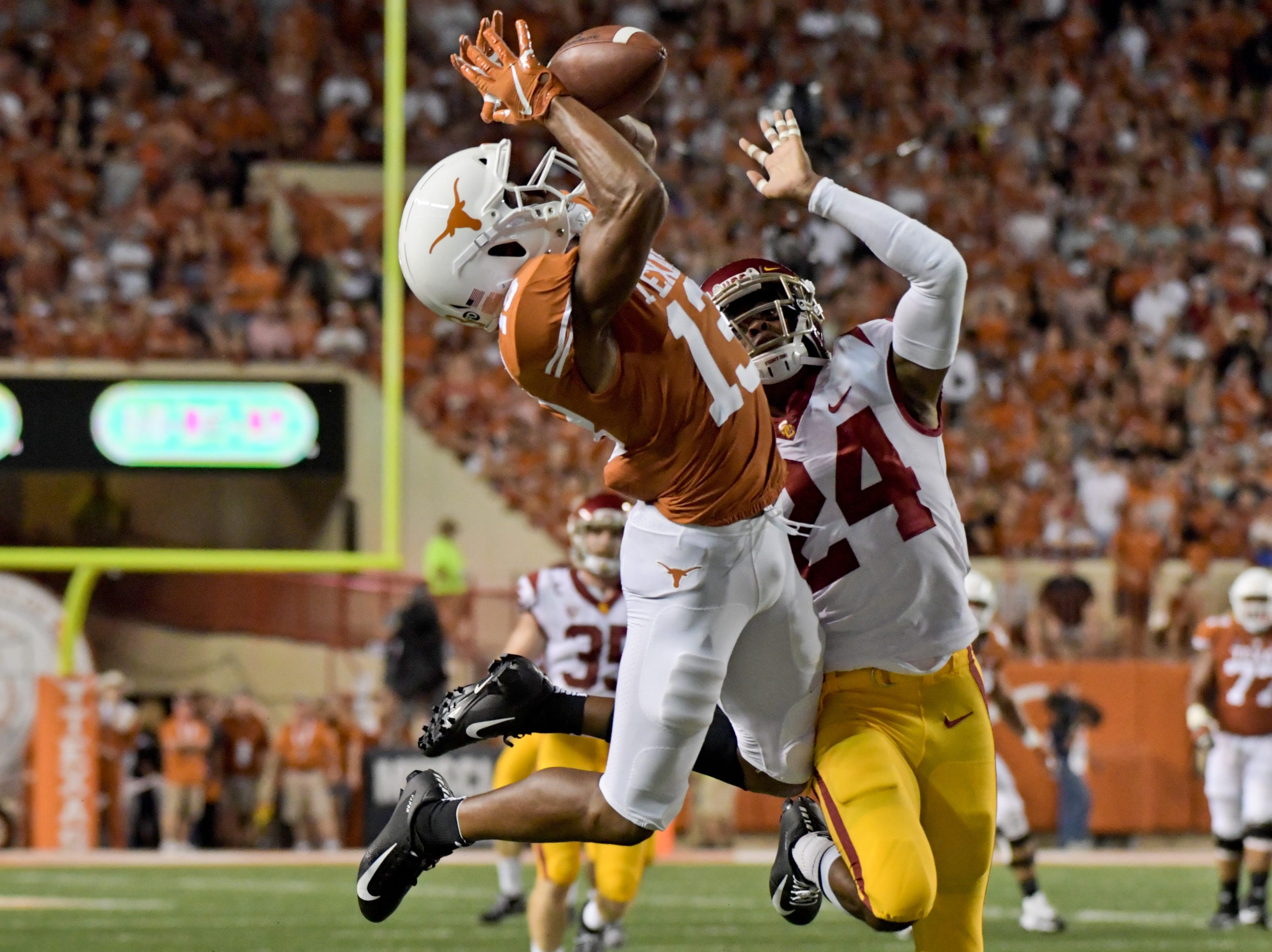 Southern California Trojans cornerback Isaiah Langley (24) breaks up a pass intended for Texas Longhorns wide receiver Jerrod Heard (13) during the first half at Darrell K Royal-Texas Memorial Stadium.