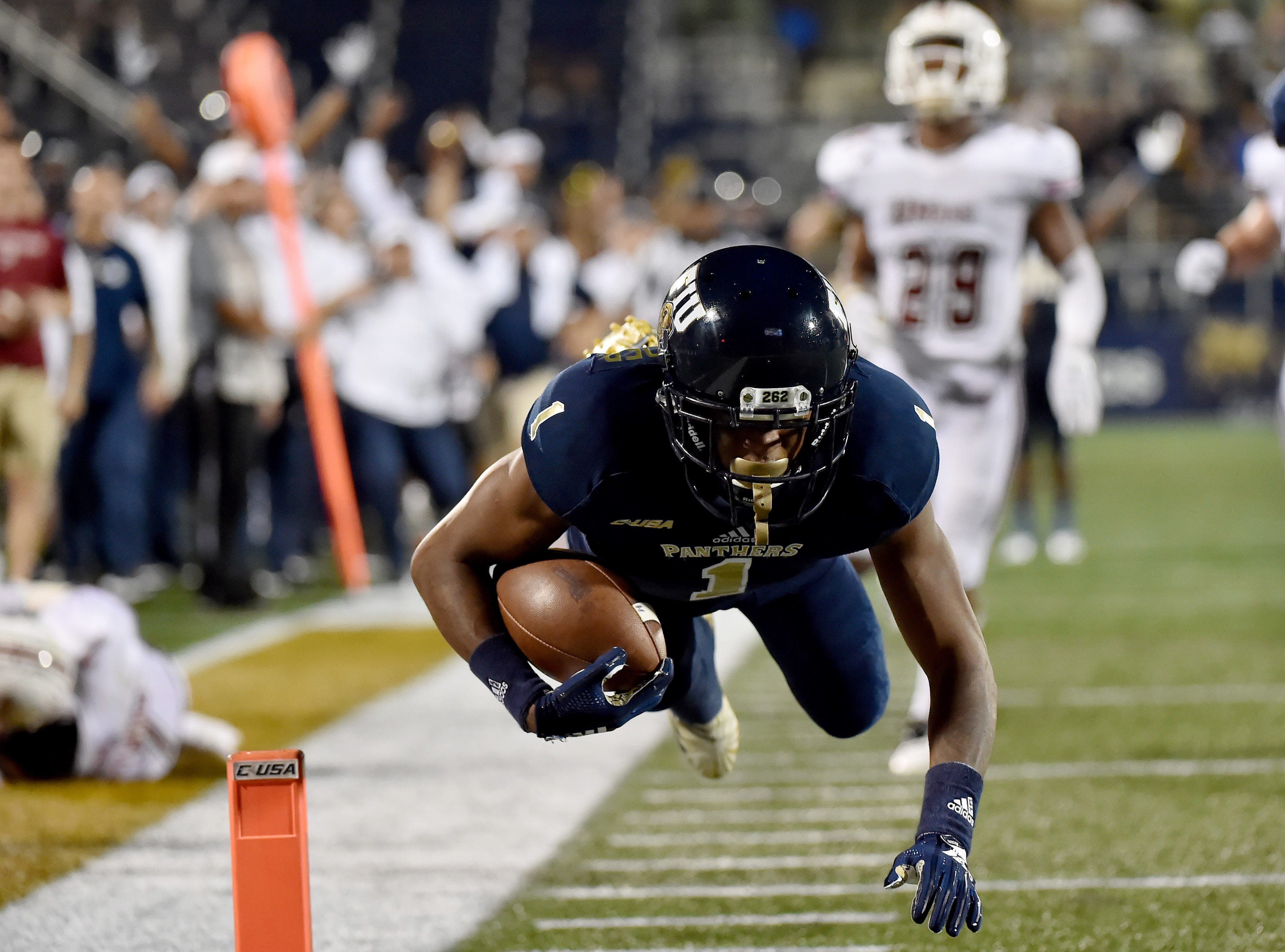 FIU Golden Panthers wide receiver Maurice Alexander (1) dives in for a touchdown against the  Massachusetts Minutemen during the second half at Riccardo Silva Stadium.
