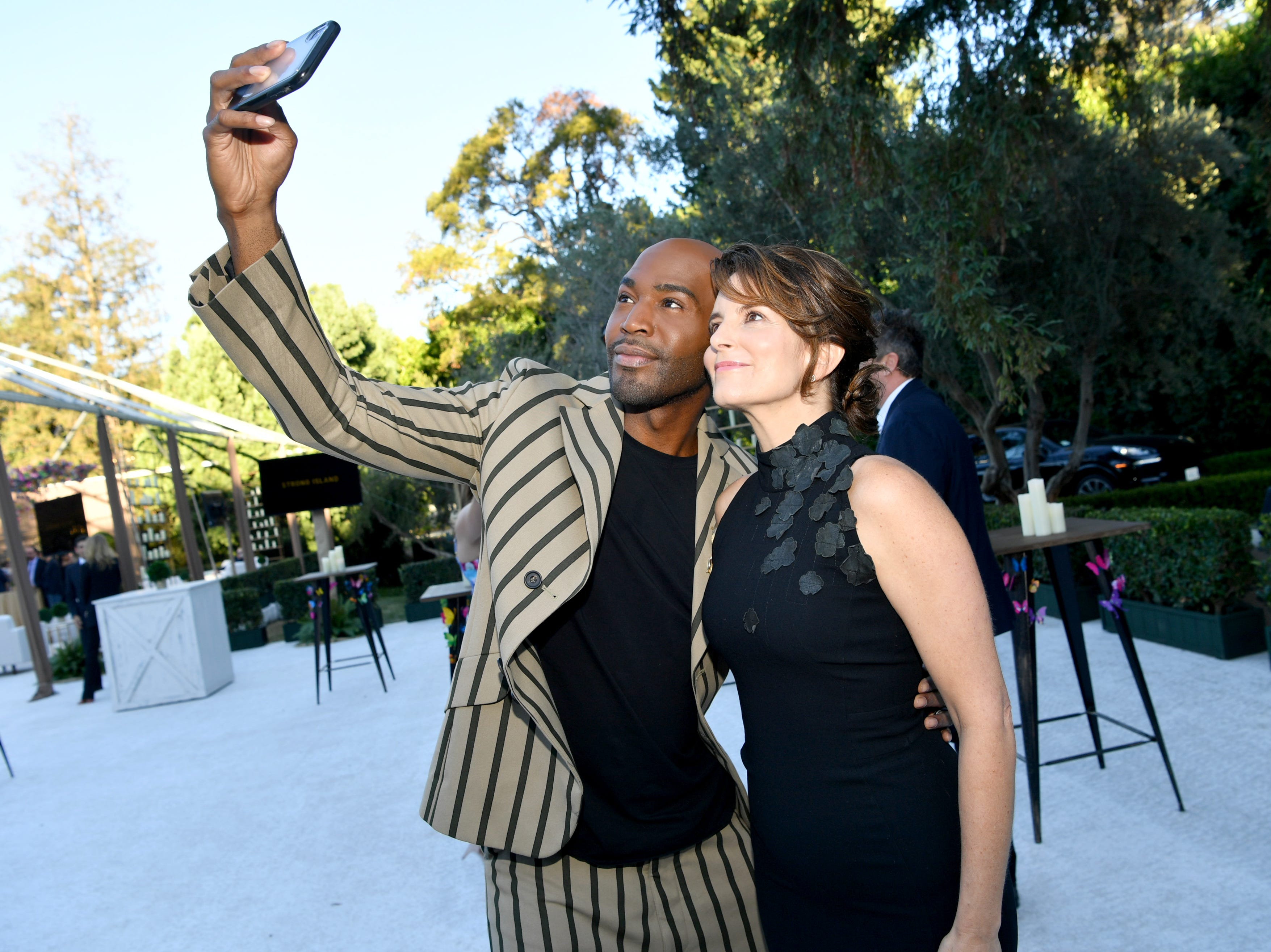 LOS ANGELES, CA - SEPTEMBER 15: Karamo Brown and Tina Fey attend Ted Sarandos' 2018 Annual Netflix Emmy Nominee Toast on September 15, 2018 in Los Angeles, California.  (Photo by Emma McIntyre/Getty Images for Netflix) ORG XMIT: 775217665 ORIG FILE ID: 1033989244