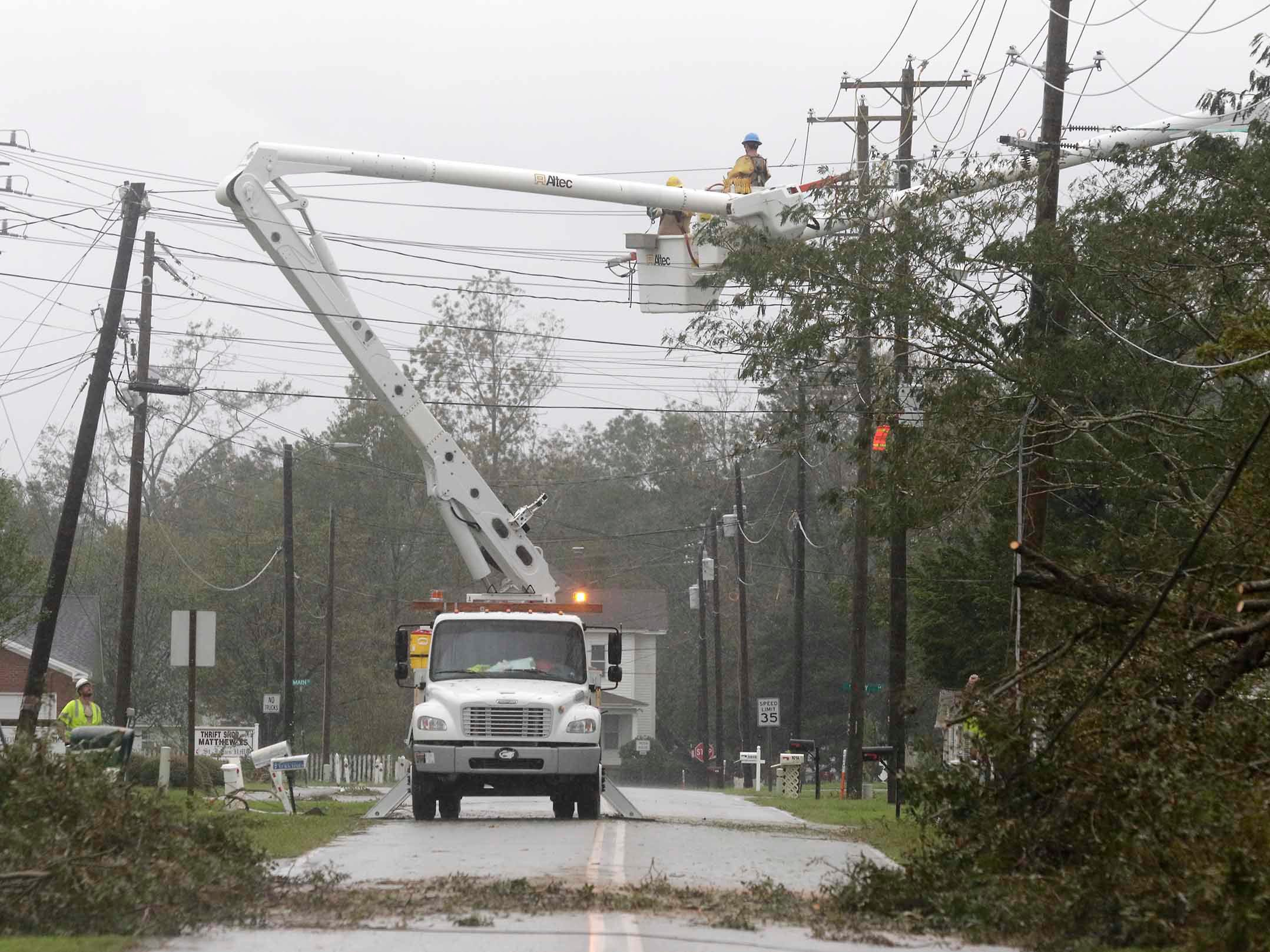 Power crews work to restore power after tropical storm Florence hit Newport N.C., on Sept. 15, 2018.