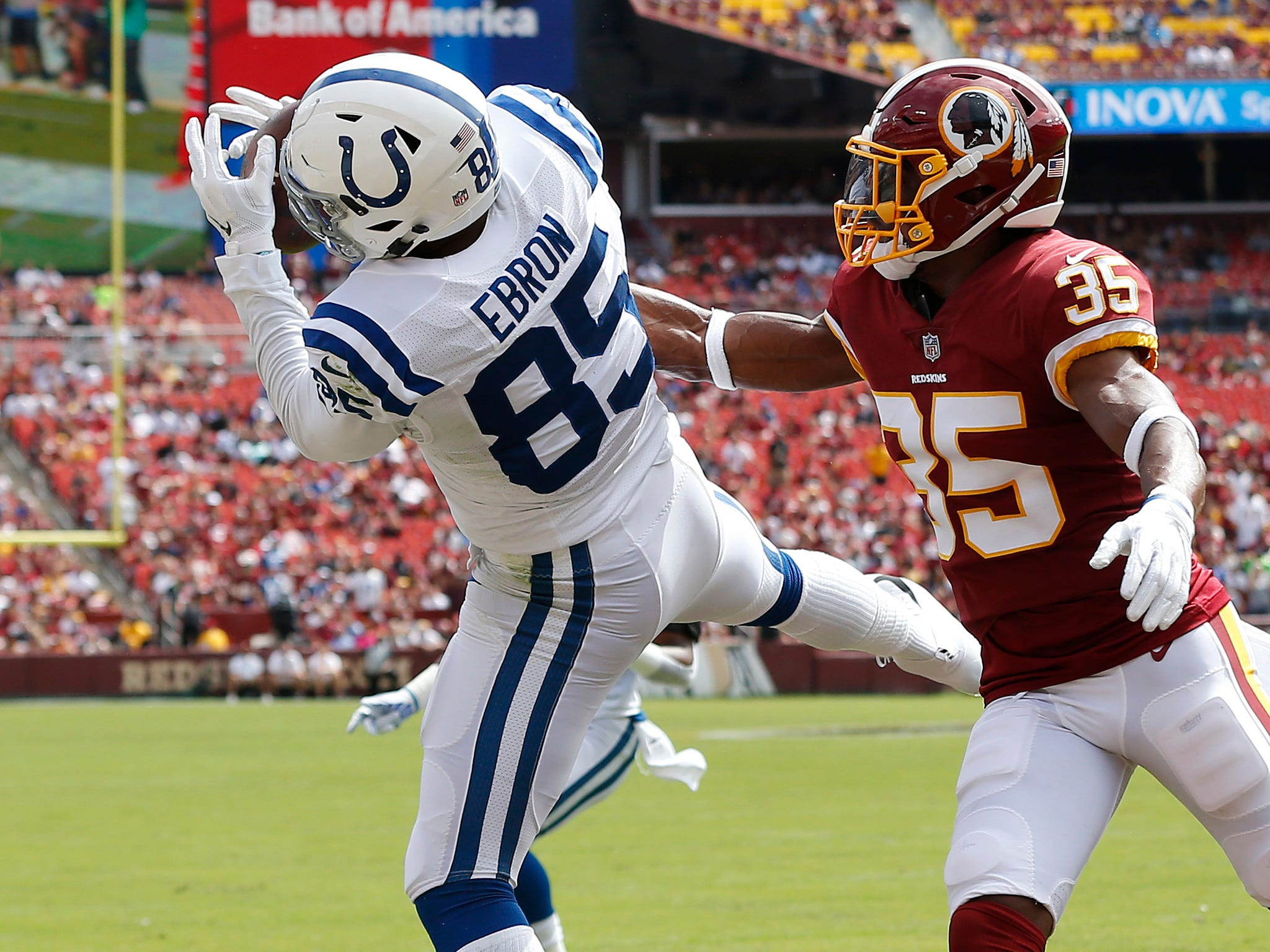 Indianapolis Colts tight end Eric Ebron catches a touchdown pass as Washington Redskins defensive back Montae Nicholson defends in the first quarter at FedEx Field.