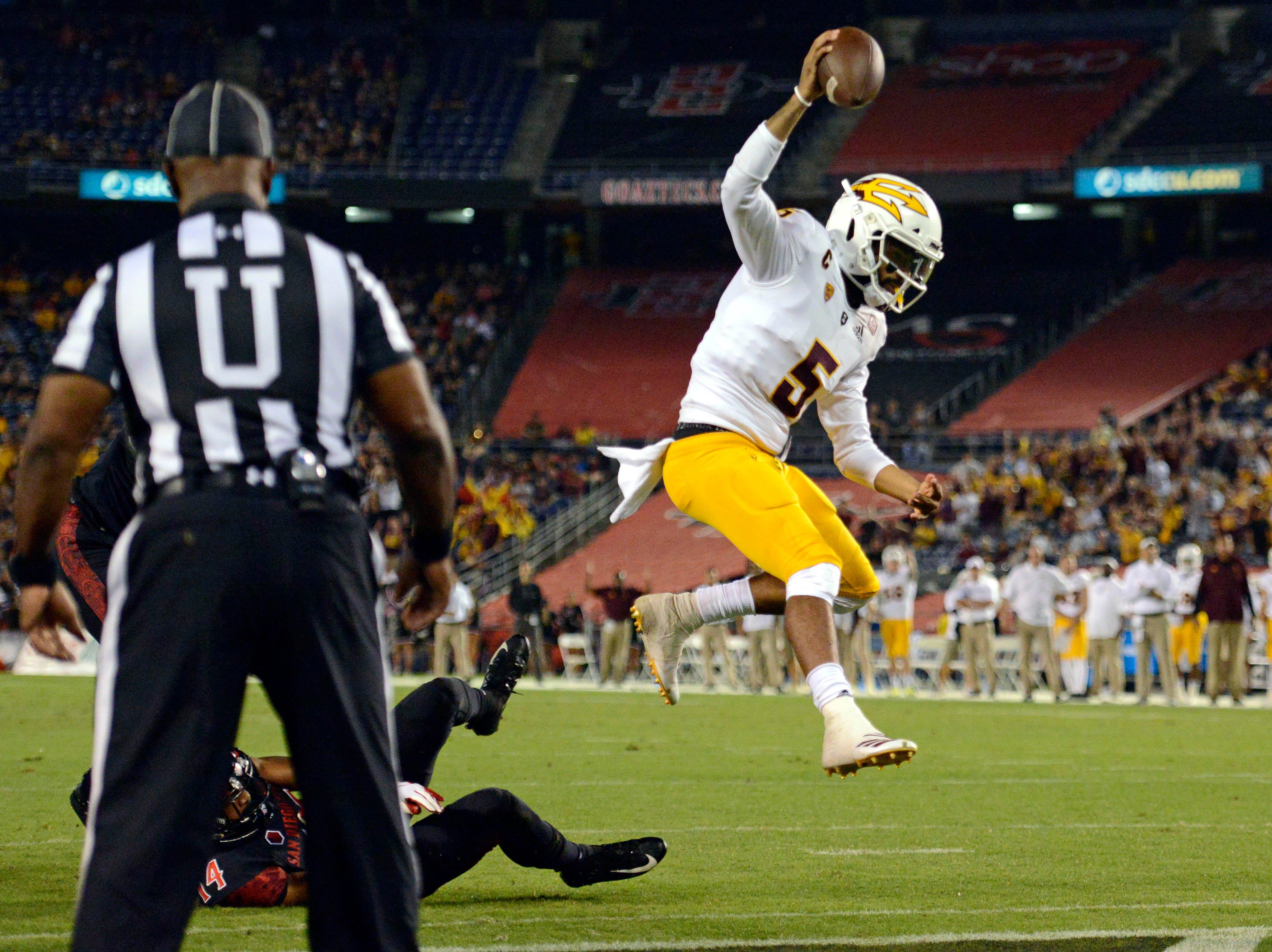 Arizona State Sun Devils quarterback Manny Wilkins (5) scores a touchdown against San Diego State Aztecs safety Tariq Thompson (14) during the second quarter at SDCCU Stadium.
