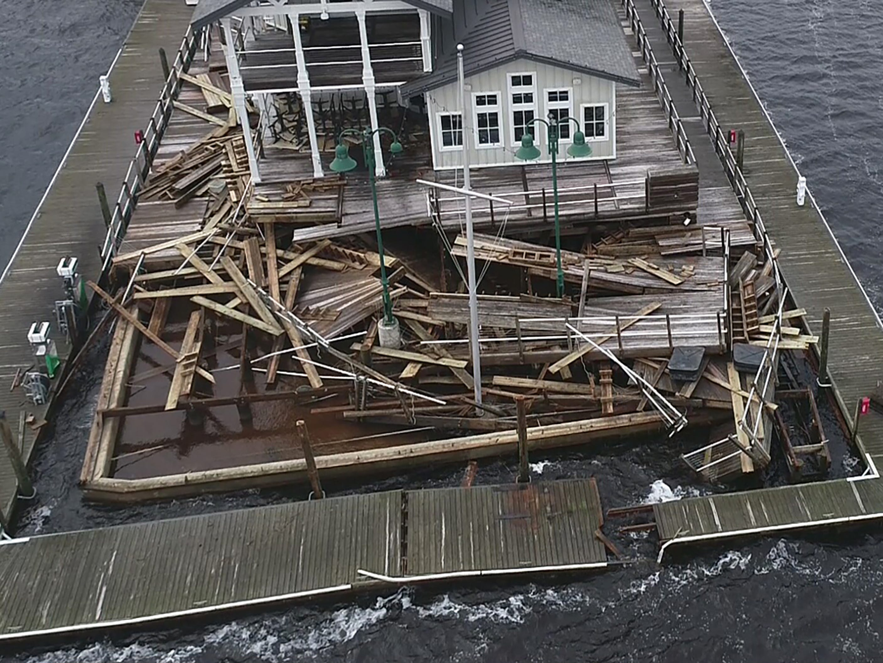The Persimmons Waterfront Restaurant suffered storm damage from Hurricane Florence in downtown New Bern, N.C. on Sunday morning on Sept. 16, 2018.