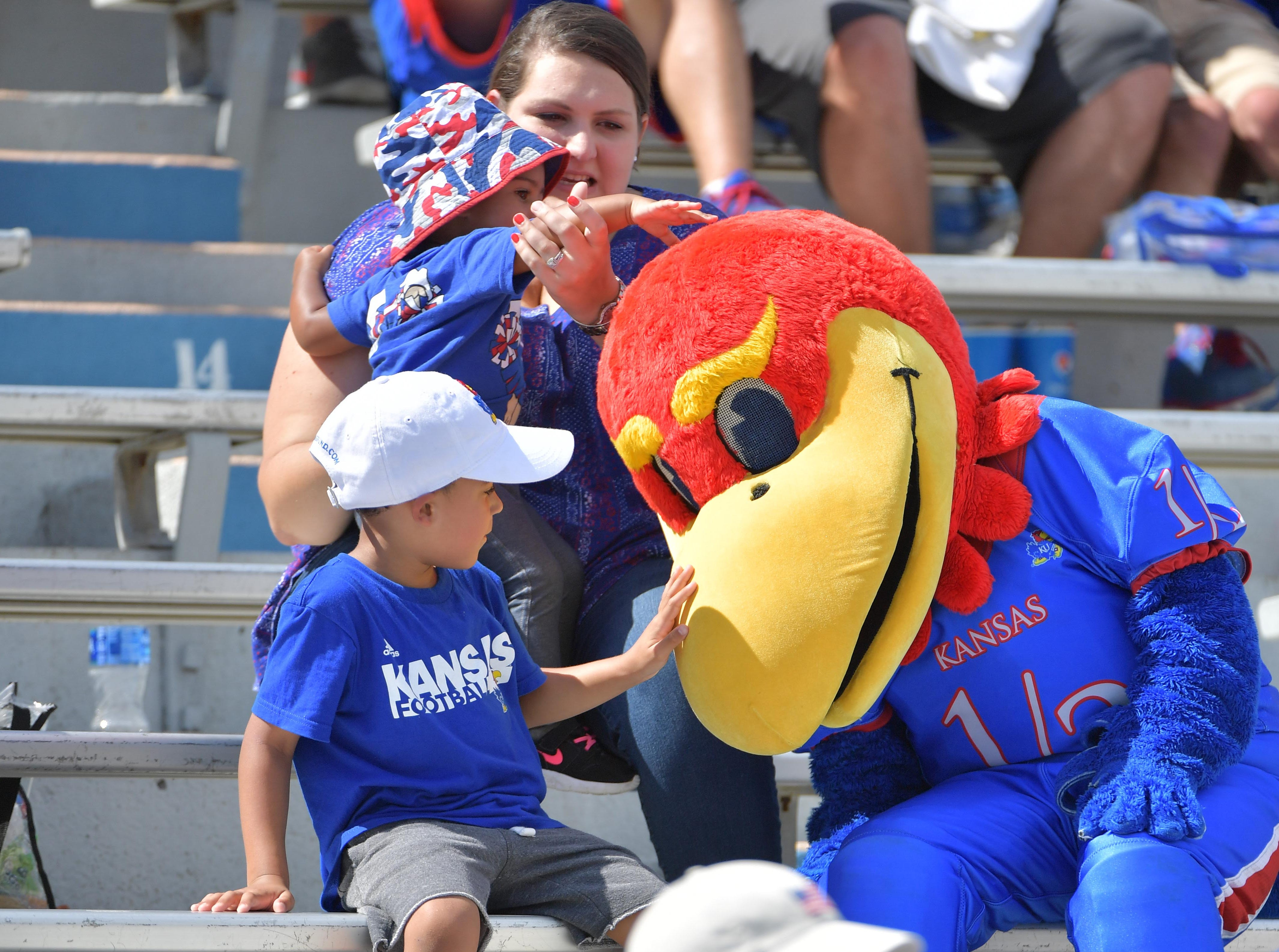 Week 3: Young Kansas Jayhawks fans pet the mascot during the second half against the Rutgers Scarlet Knights.