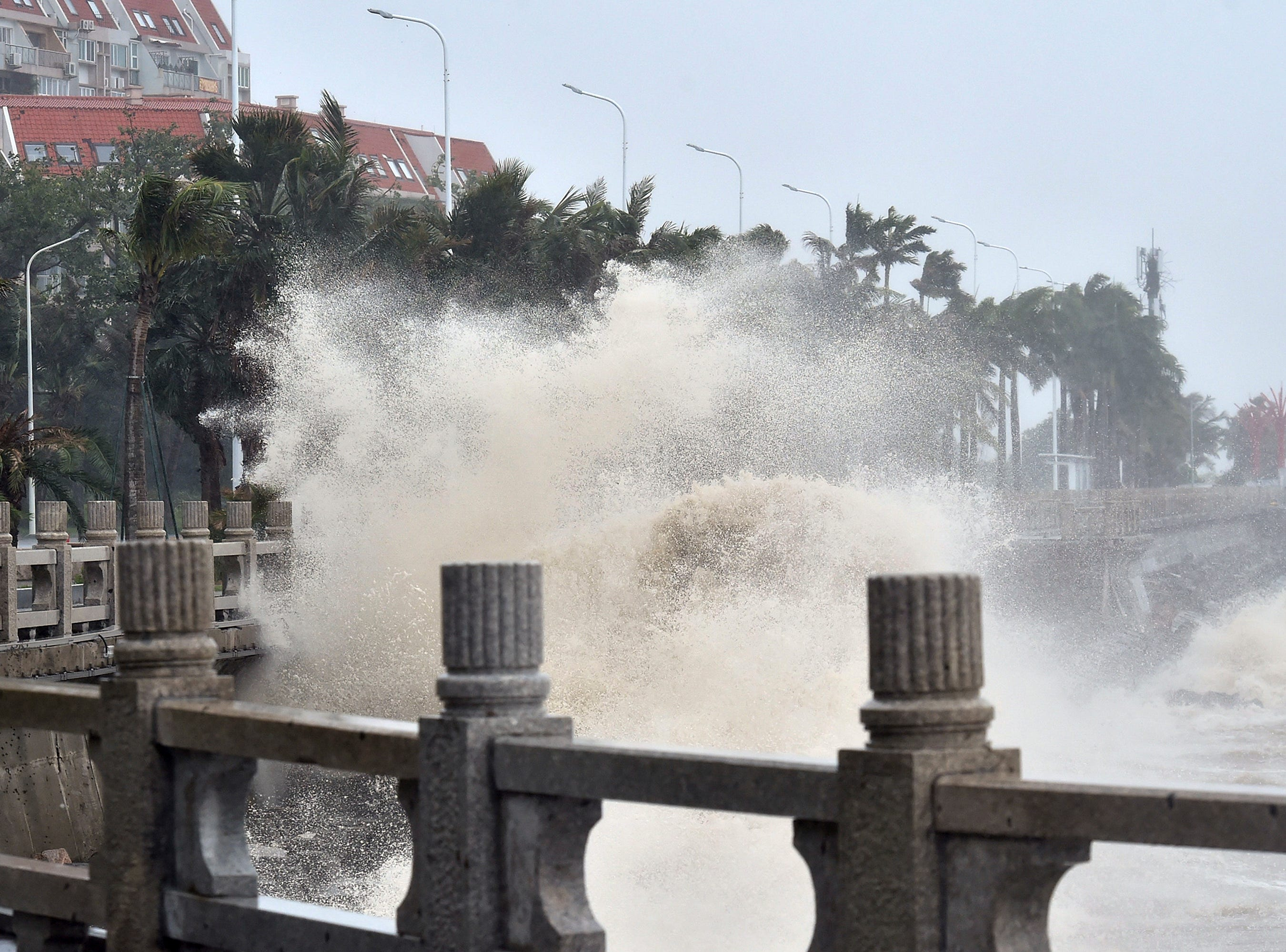 Waves crash onto the coastline in Zhuhai in southern China's Guangdong Province on Sunday, Sept. 16, 2018. Typhoon Mangkhut barrelled into southern China on Sunday after lashing the northern Philippines with strong winds and heavy rain that left at least 64 people dead and dozens more feared buried in a landslide.