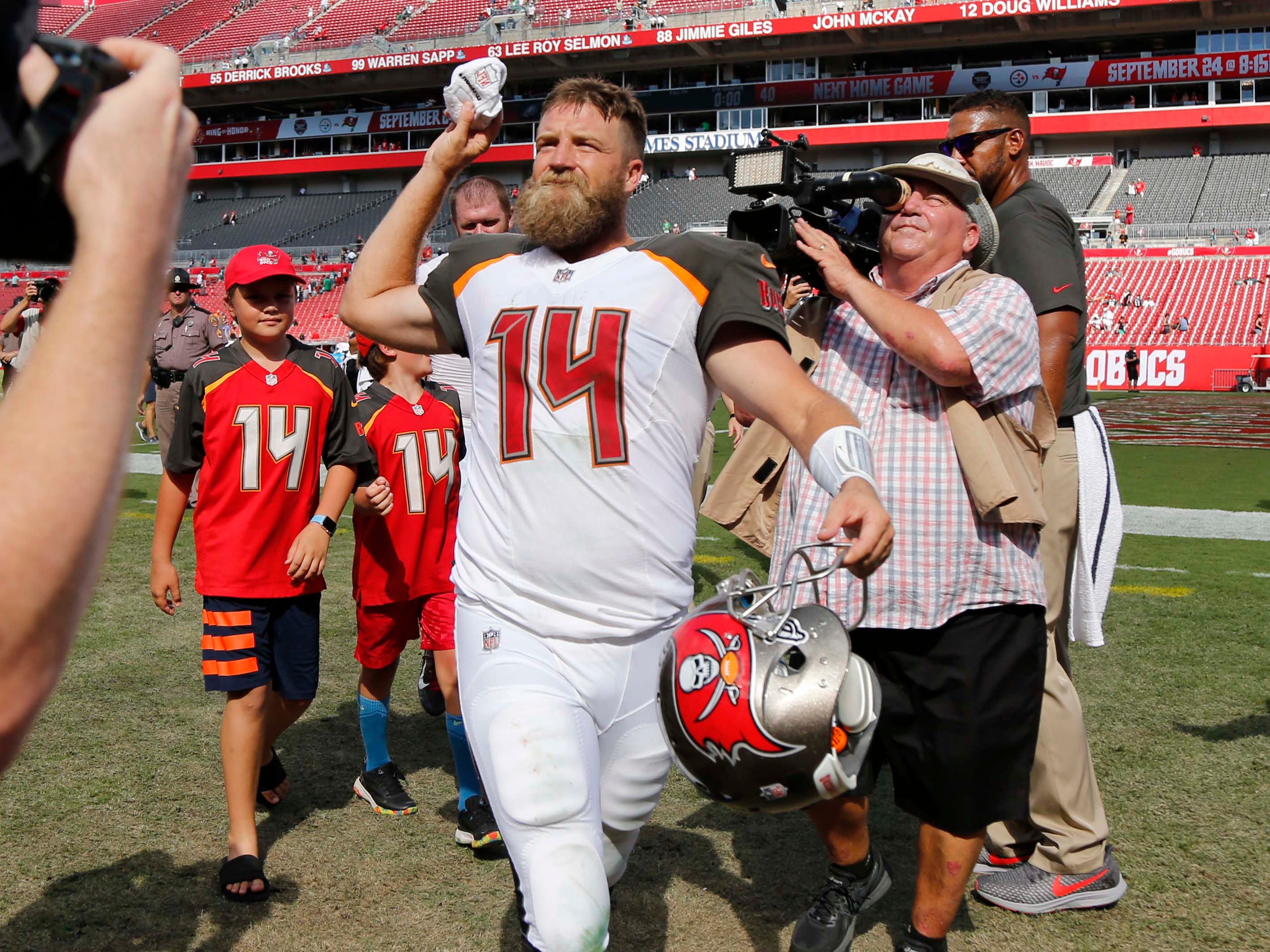 Sep 16, 2018; Tampa, FL, USA;Tampa Bay Buccaneers quarterback Ryan Fitzpatrick (14) runs off the field as they beat the Philadelphia Eagles at Raymond James Stadium. Mandatory Credit: Kim Klement-USA TODAY Sports
