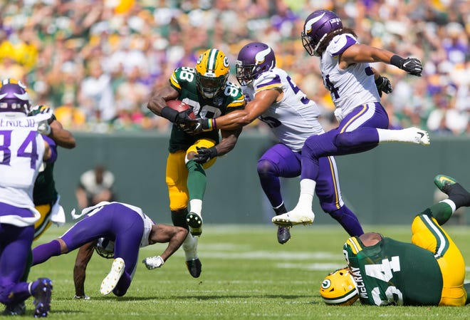 Green Bay Packers running back Ty Montgomery (88) leaps over a defender as Minnesota Vikings linebacker Anthony Barr (55) and linebacker Eric Kendricks (54) chase during the second quarter at Lambeau Field.