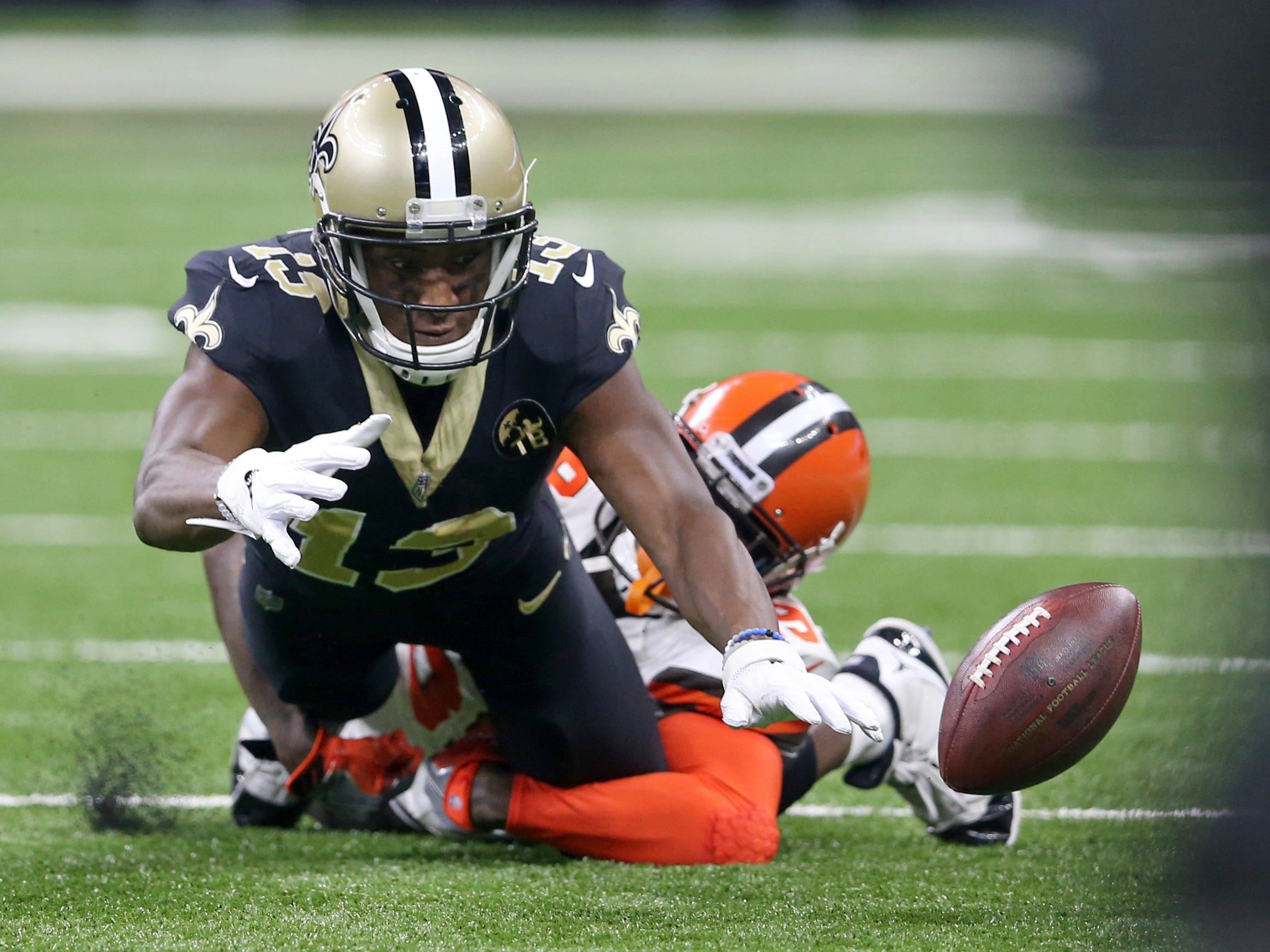 New Orleans Saints wide receiver Michael Thomas fumbles the ball after being hit by Cleveland Browns defensive back Terrance Mitchell in the first quarter at Mercedes-Benz Superdome.