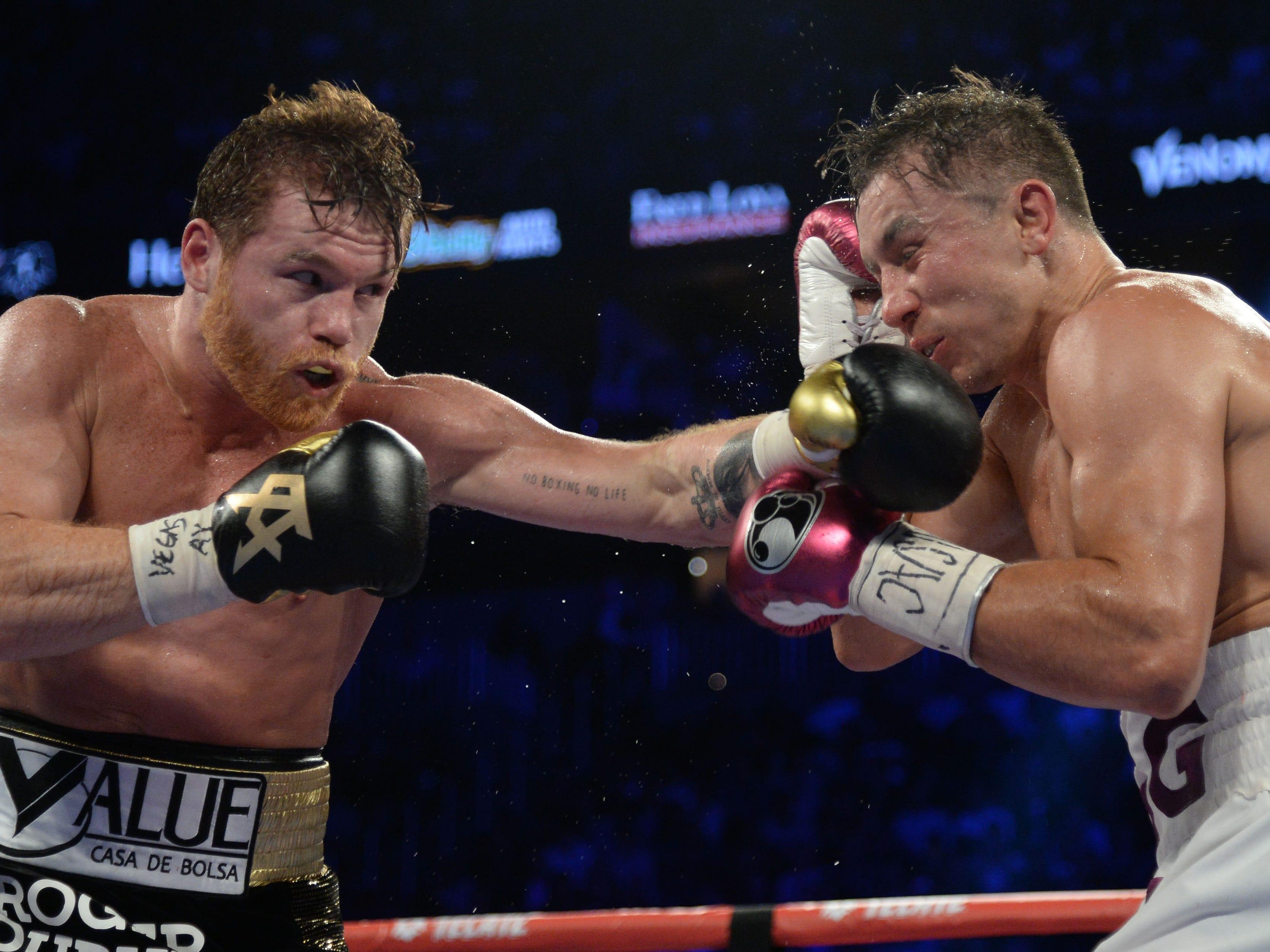 Canelo Alvarez, left, lands a punch against Gennady Golovkin.