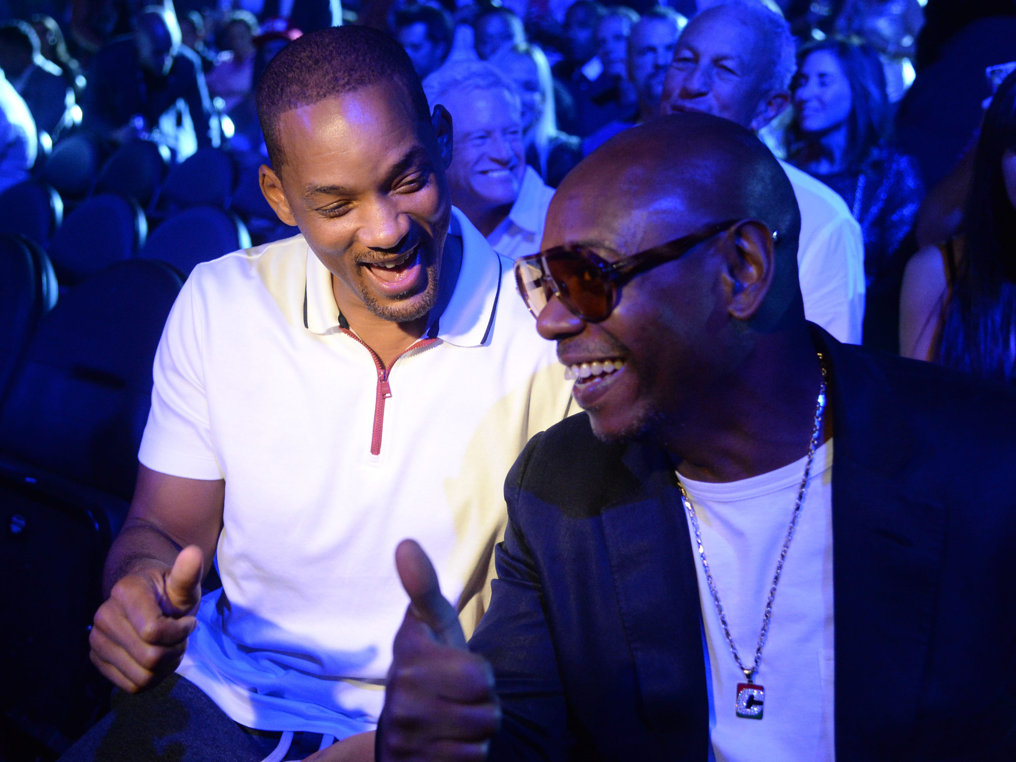 Will Smith, left, and Dave Chappelle sit ringside.