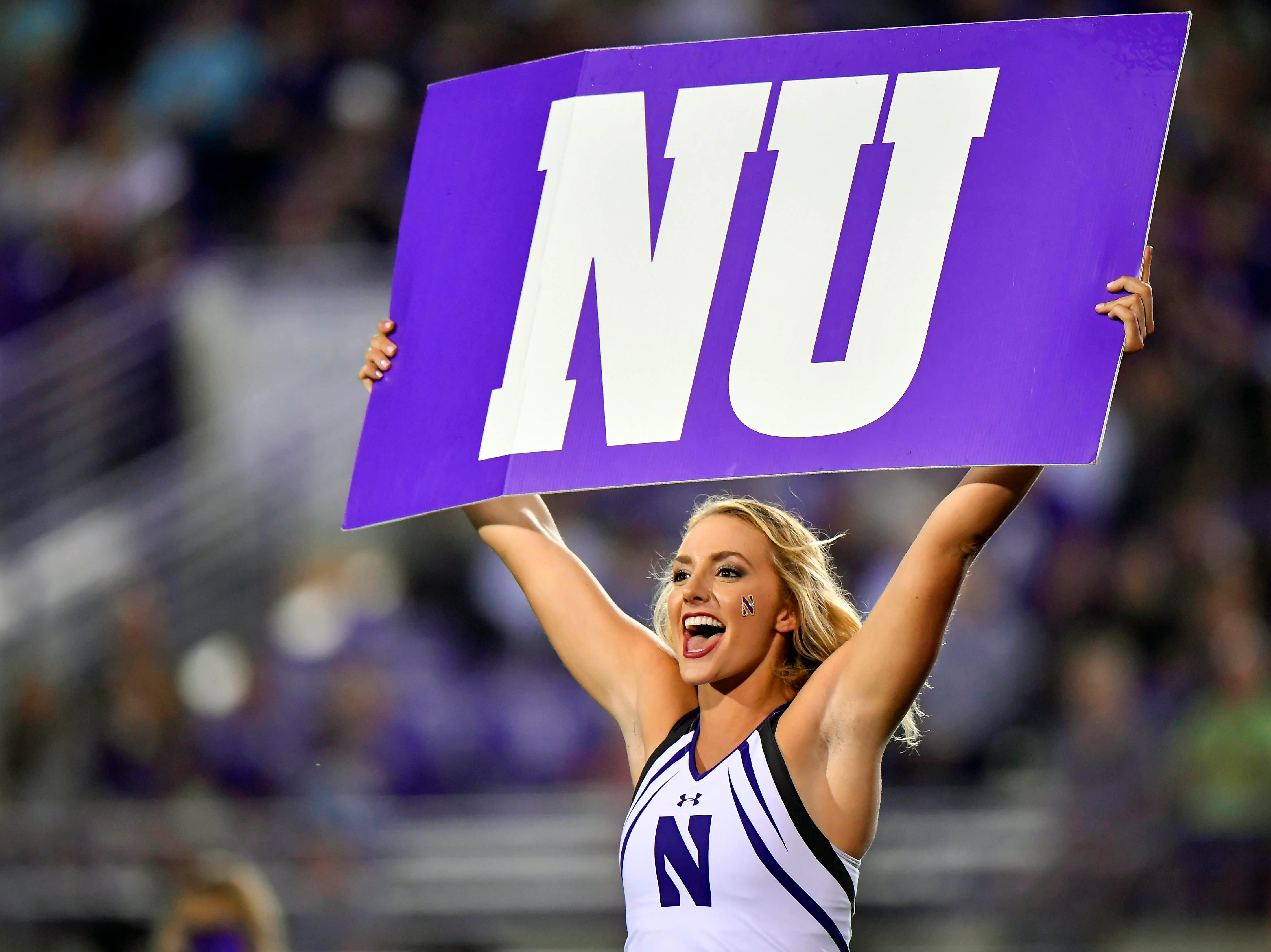 Week 3: A Northwestern Wildcats cheerleader cheers during the game against the Akron Zips at Ryan Field.
