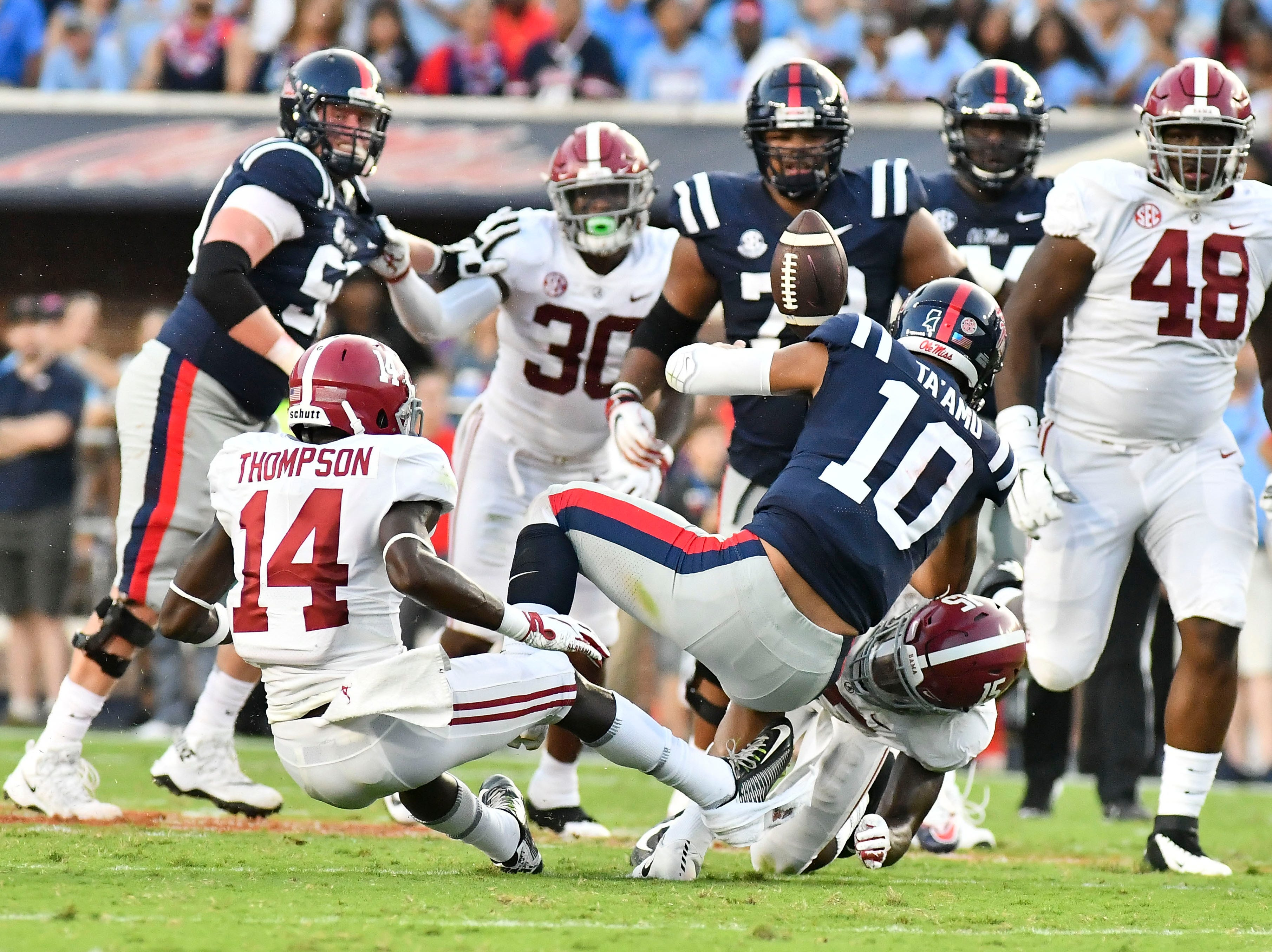 Mississippi Rebels quarterback Jordan Ta'amu (10) fumbles the ball after being hit by Alabama Crimson Tide defensive back Xavier McKinney (15) during the first quarter at Vaught-Hemingway Stadium.