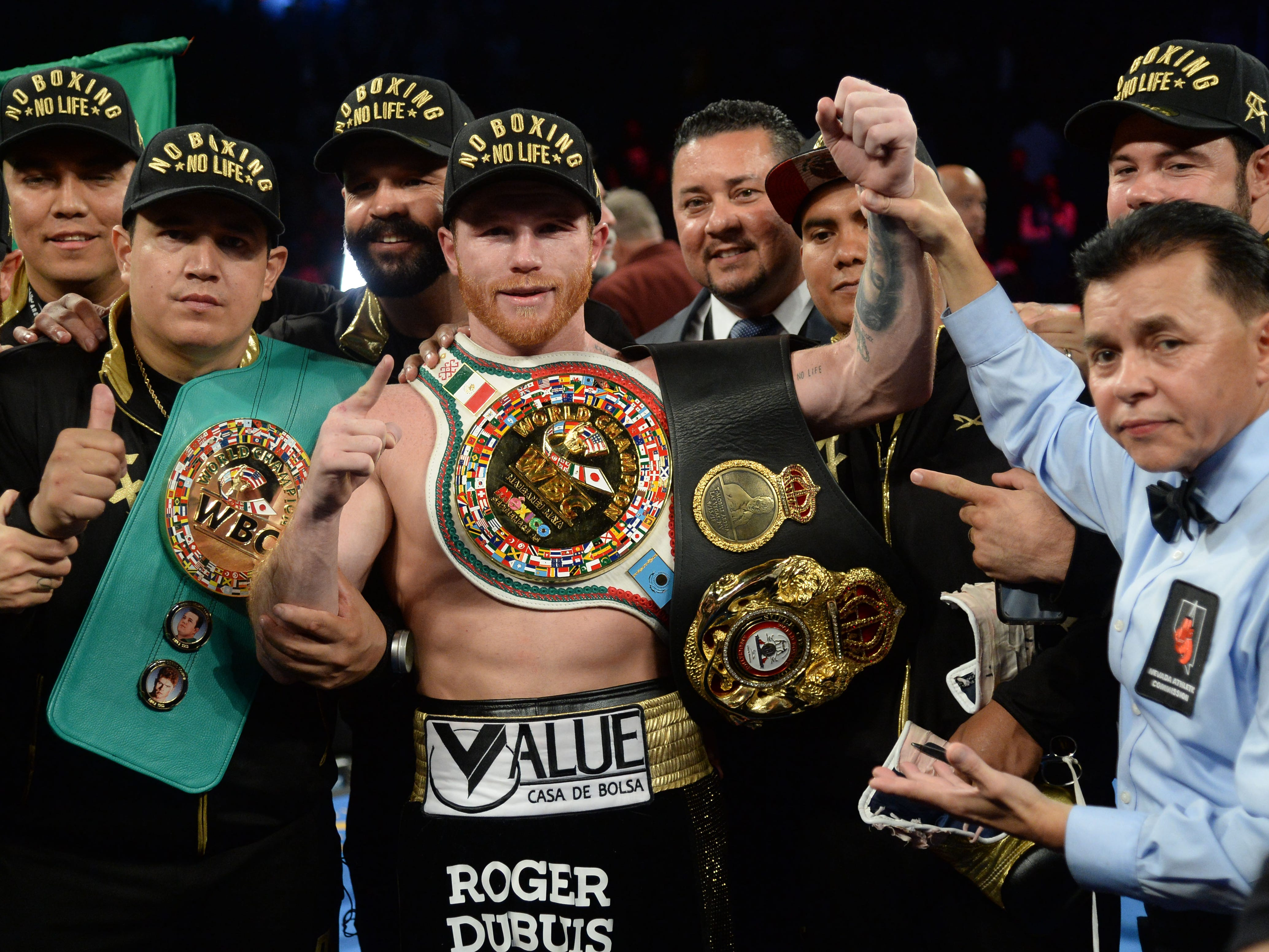 Canelo Alvarez celebrates after defeating Gennady Golovkin by a majority decision in their highly anticipated middleweight championship rematch in Las Vegas.