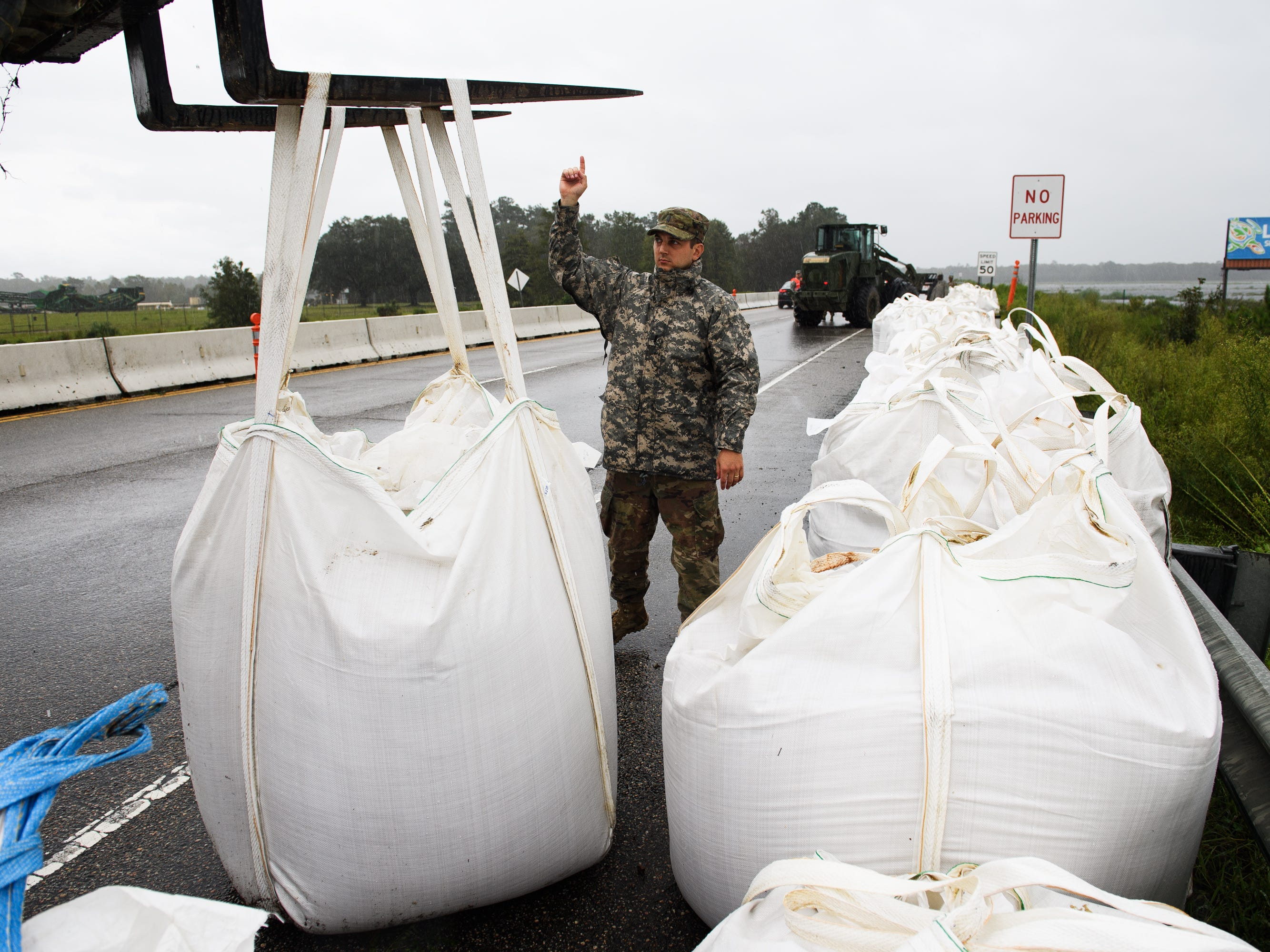 Engineering units of the South Carolina Army National Guard lay down sand bags along U.S. 501 South just outside of Conway, S.C. on Sunday, Sept. 16, 2018, in preparation of rising water levels on the Waccamaw River due to Florence.