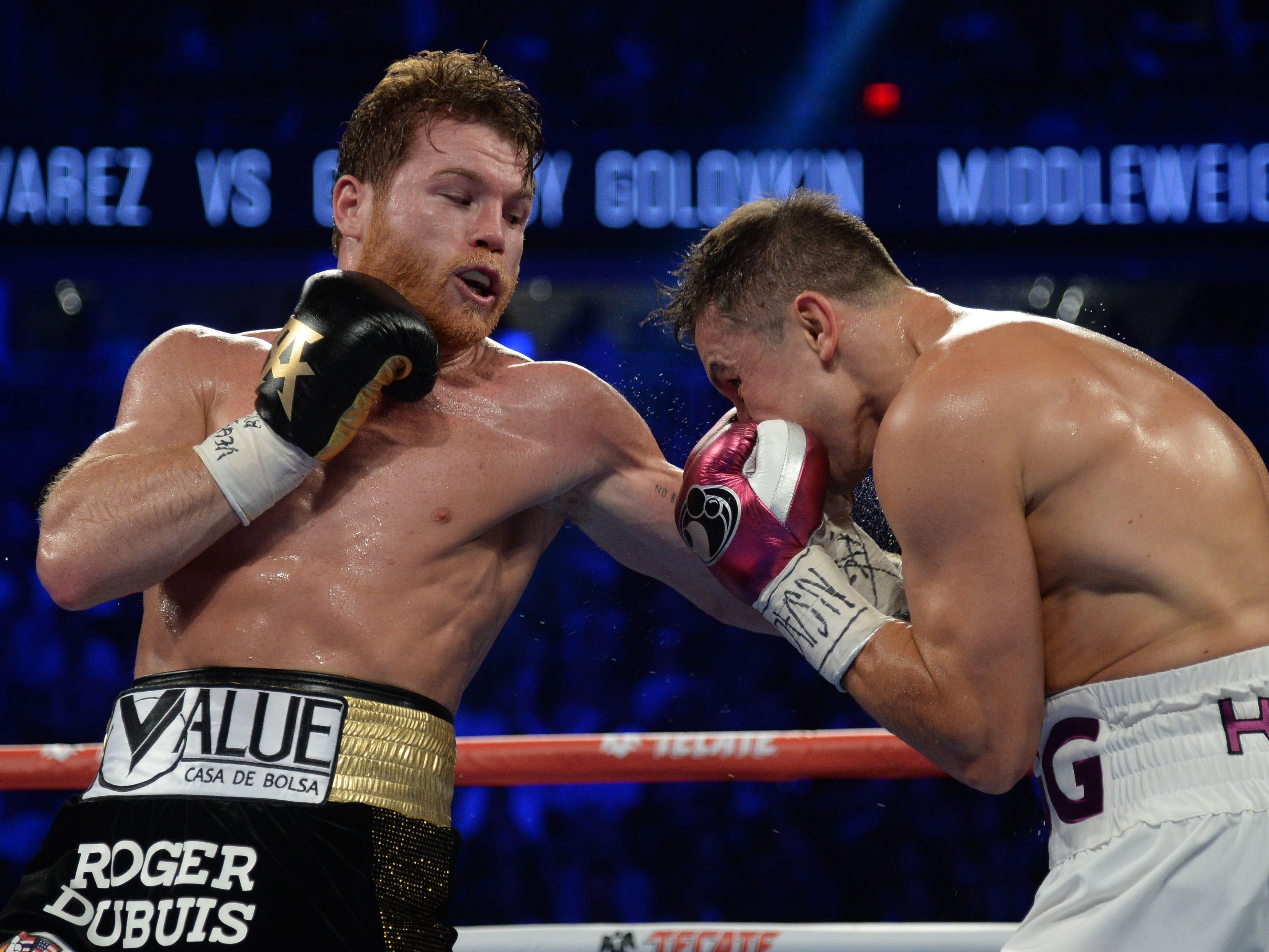 Alvarez throws a punch at Golovkin.