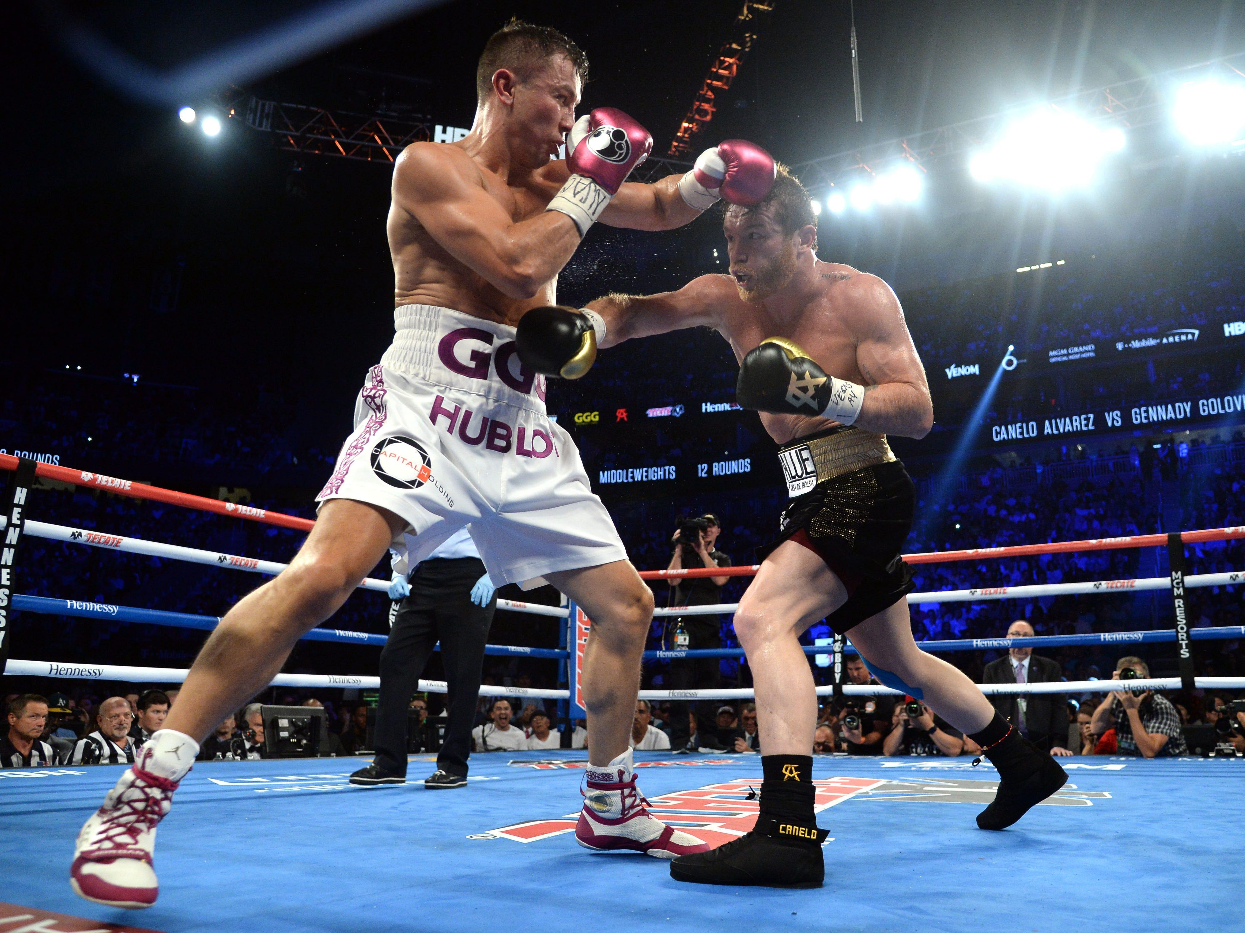 Alvarez and Golovkin trade punches.
