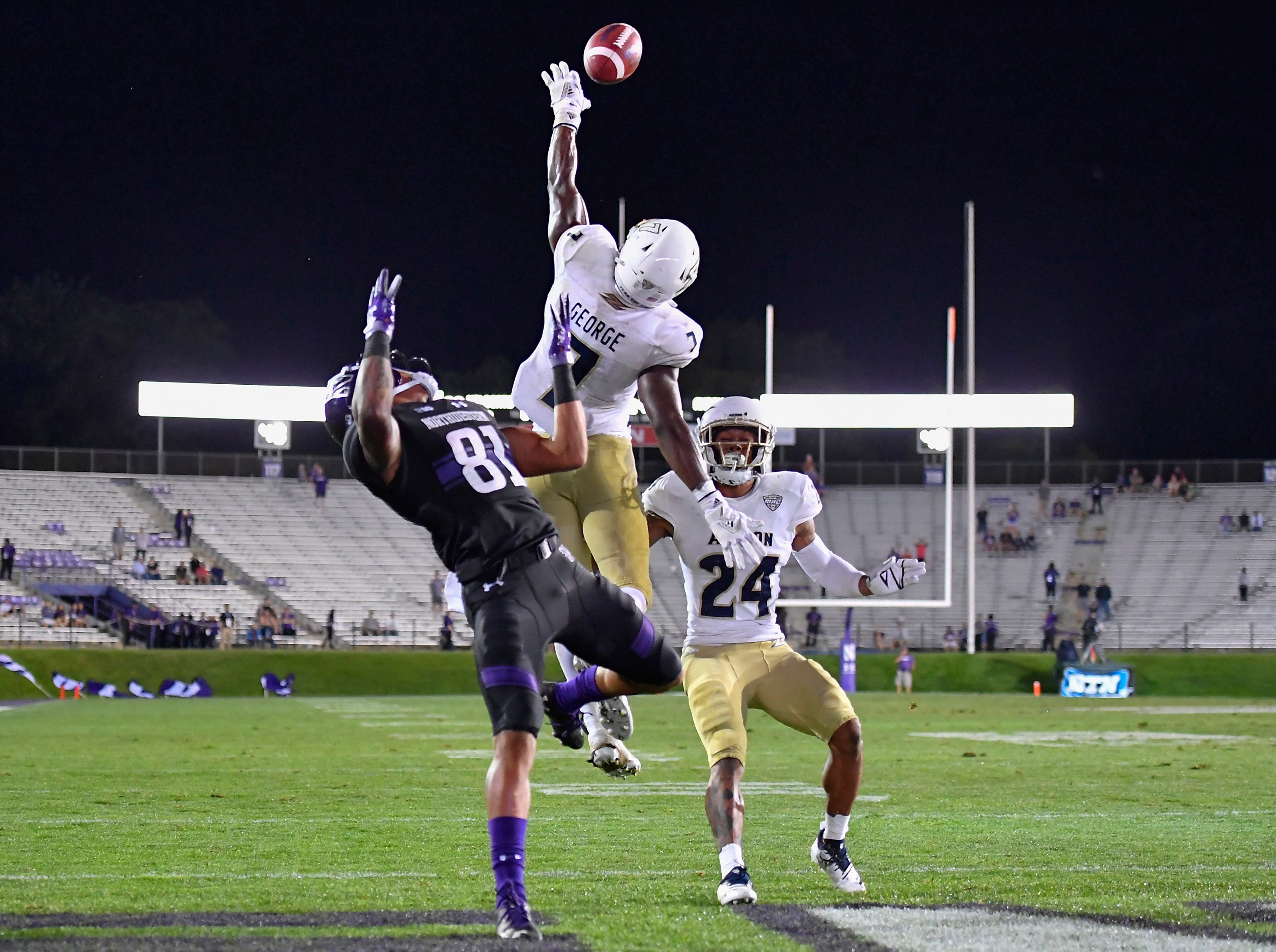 Akron Zips defensive back Jordan George (7) deflects the pass intended for Northwestern Wildcats wide receiver Ramaud Chiaokhiao-Bowman (81) at Ryan Field.