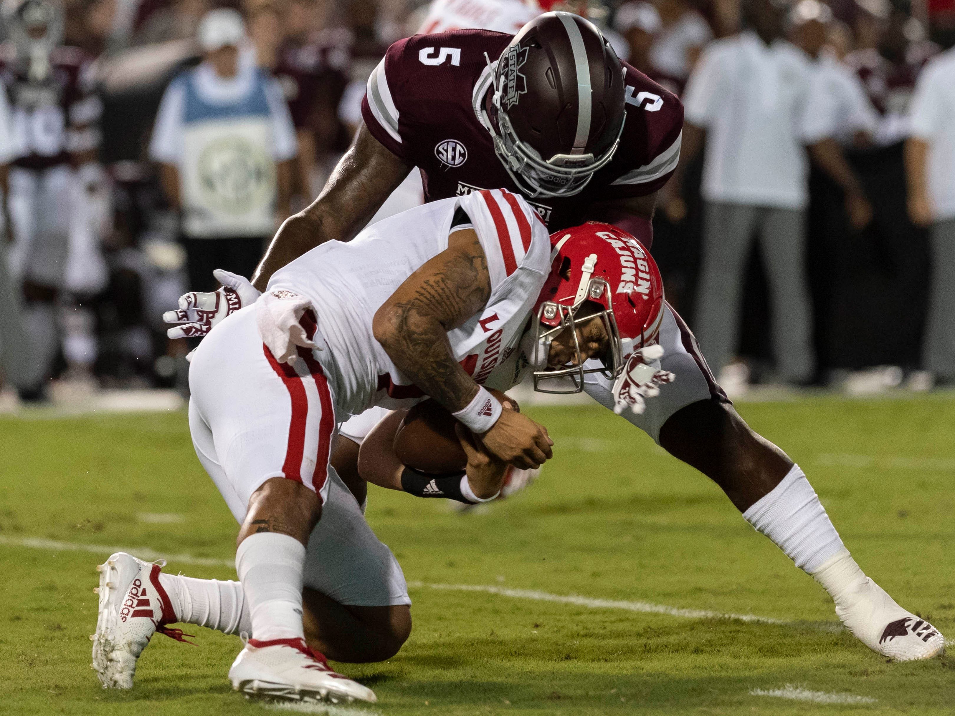 Mississippi State Bulldogs defensive lineman Chauncey Rivers (5) tackles UL Lafayette Ragin' Cajuns quarterback Andre Nunez (7) during the first half at Davis Wade Stadium.