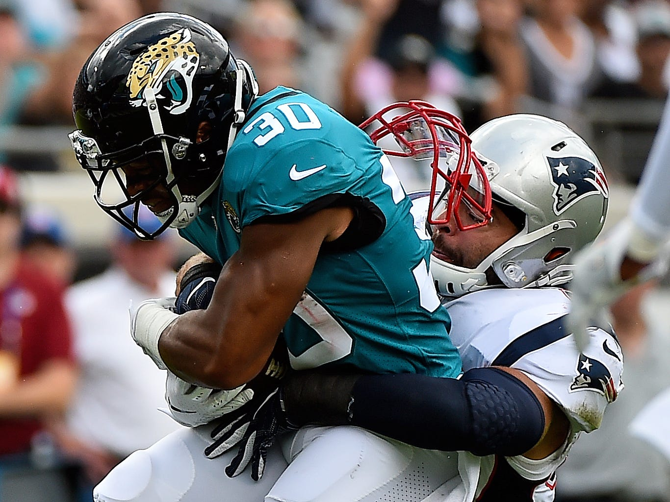 Sep 16, 2018; Jacksonville, FL, USA; New England Patriots linebacker Kyle Van Noy (53) tackles Jacksonville Jaguars running back Corey Grant (30) during the first half at TIAA Bank Field. Mandatory Credit: Jasen Vinlove-USA TODAY Sports