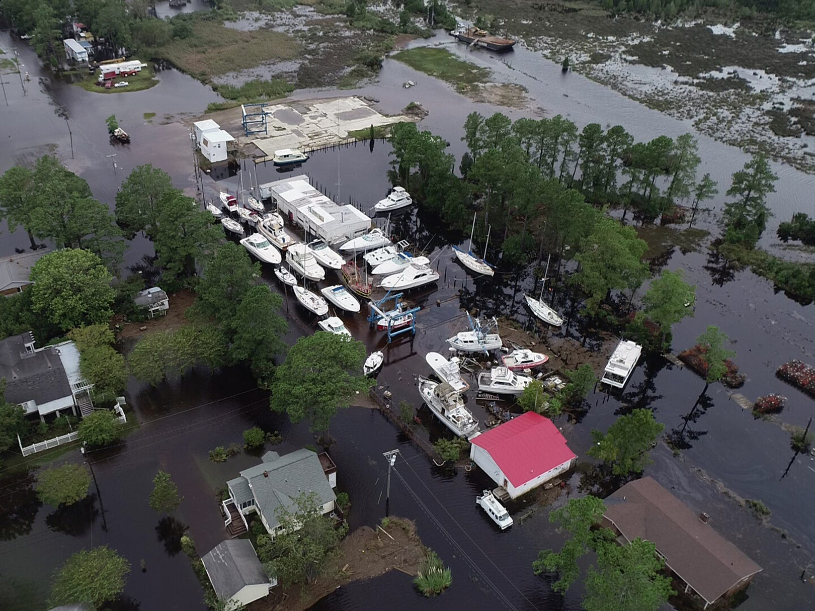 The River Forest Boatyard in the middle of flooded neighborhoods in Belhaven, N.C on  Sept. 15, 2018.