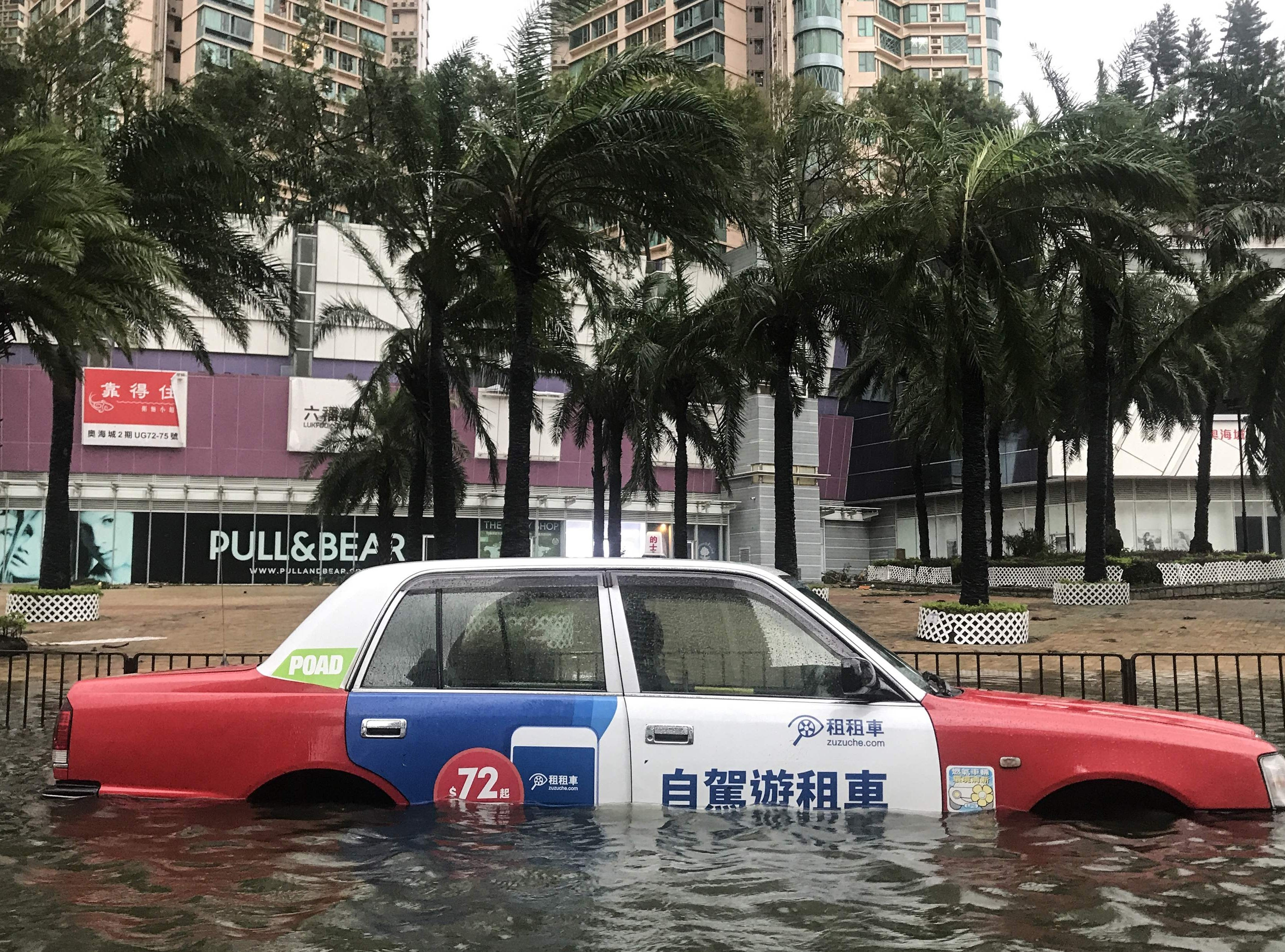 A taxi is left abandoned after breaking down in floodwaters during Super Typhoon Mangkhut in Hong Kong on Sept. 16, 2018.