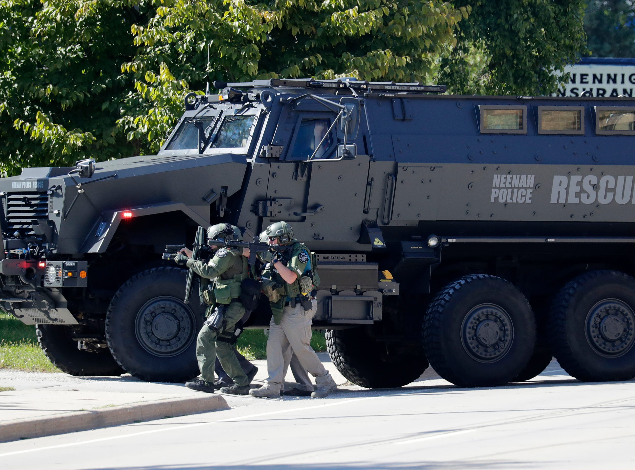 """Officials move towards a home during an """"active situation"""" at 628 Main Street Monday, Sept. 10, 2018, in Neenah, Wis. Dan Powers/USA TODAY NETWORK-Wisconsin"""