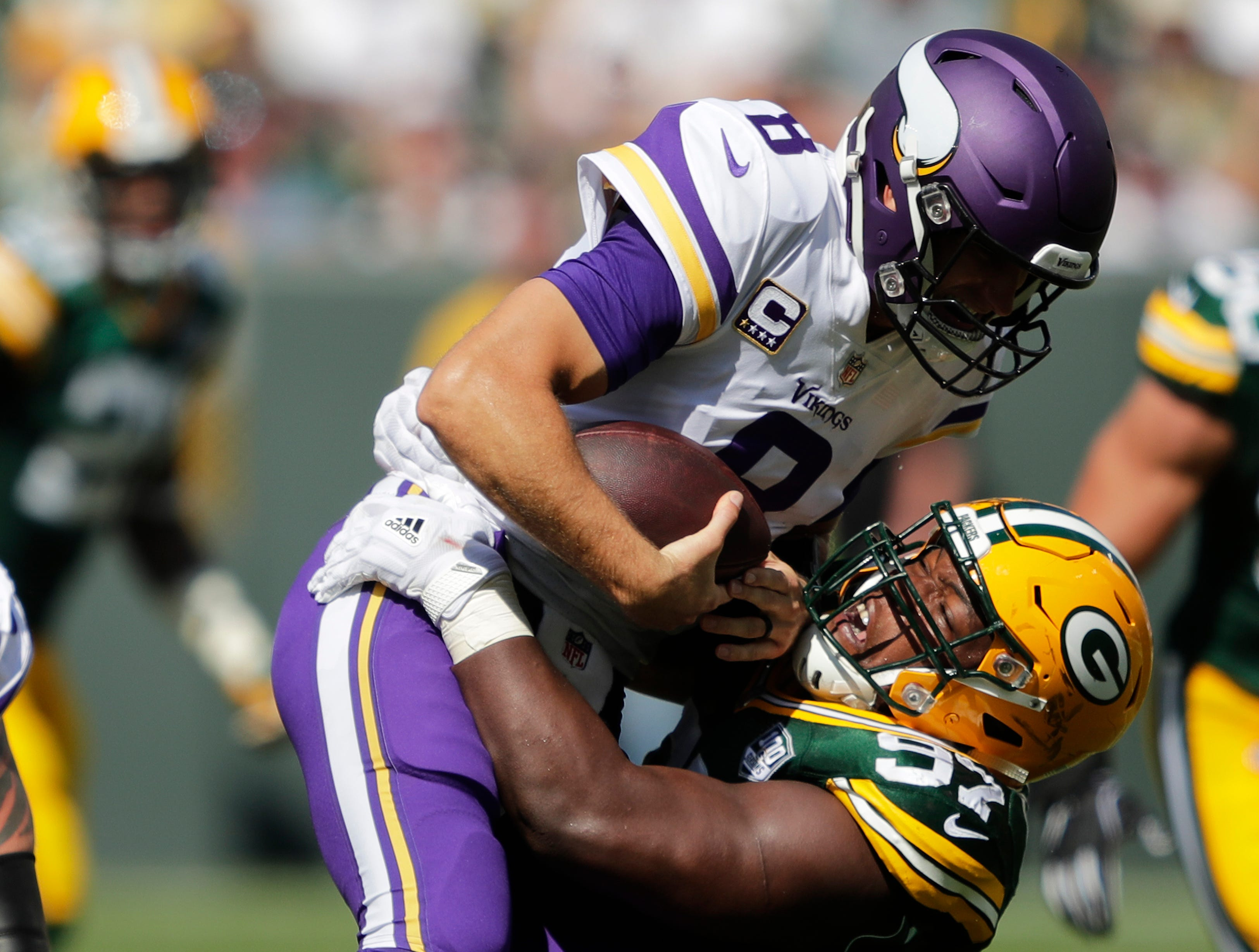 Green Bay Packers nose tackle Kenny Clark (97) sacks Minnesota Vikings quarterback Kirk Cousins (8) in the third quarter during their football game Sunday, Sept. 16, 2018, at Lambeau Field in Green Bay, Wis. Dan Powers/USA TODAY NETWORK-Wisconsin